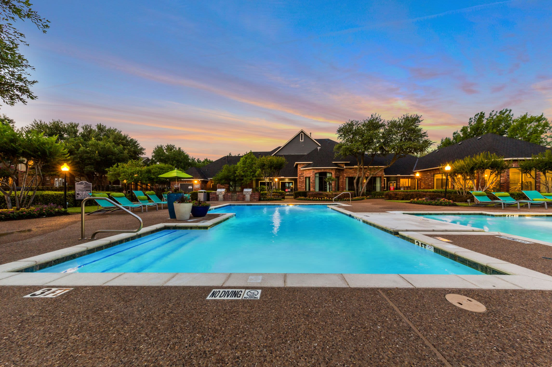 Lit pool at sunset at Marquis at Stonebriar in Frisco, Texas
