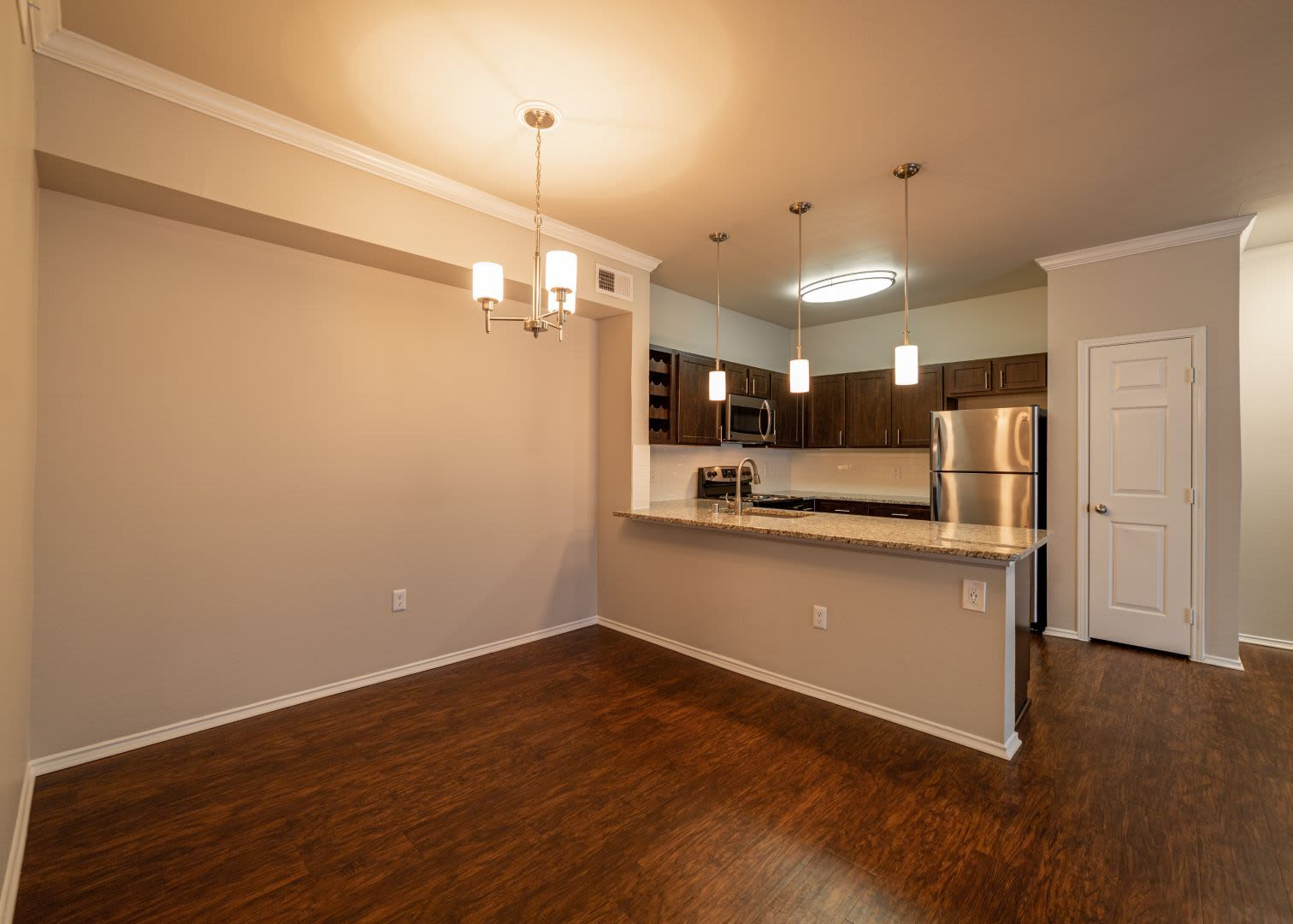 Spacious dining area next to kitchen at Marquis at Stonebriar in Frisco, Texas