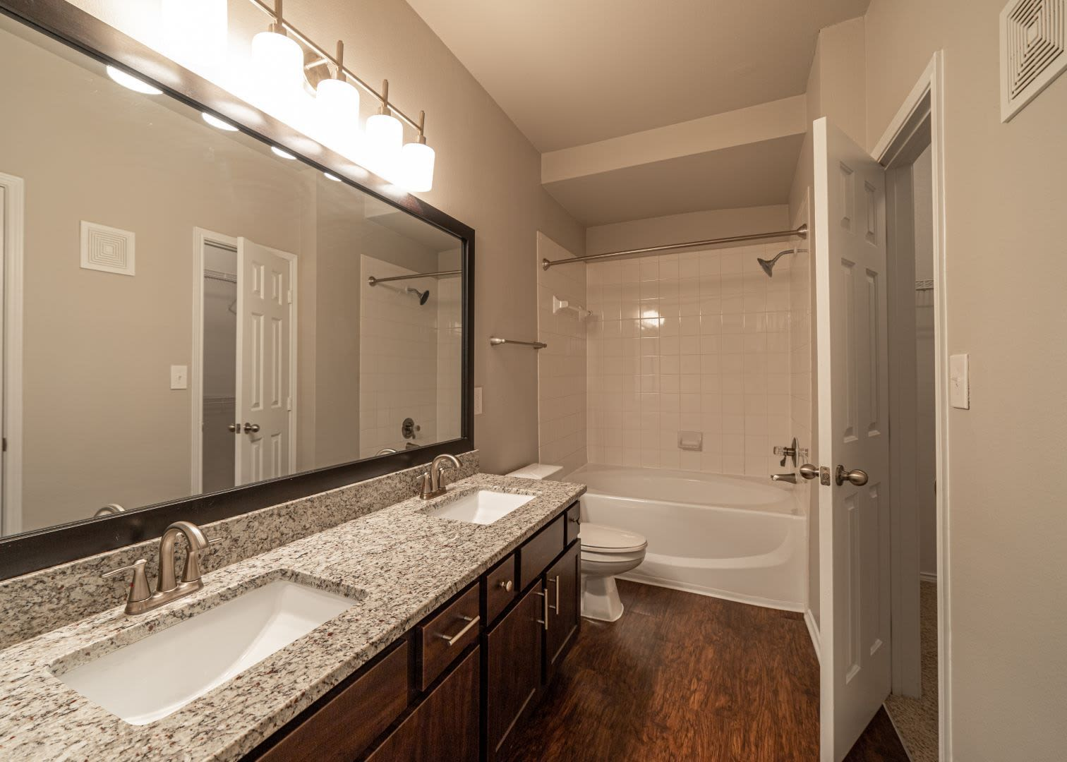Bathroom with double sinks at Marquis at Stonebriar in Frisco, Texas
