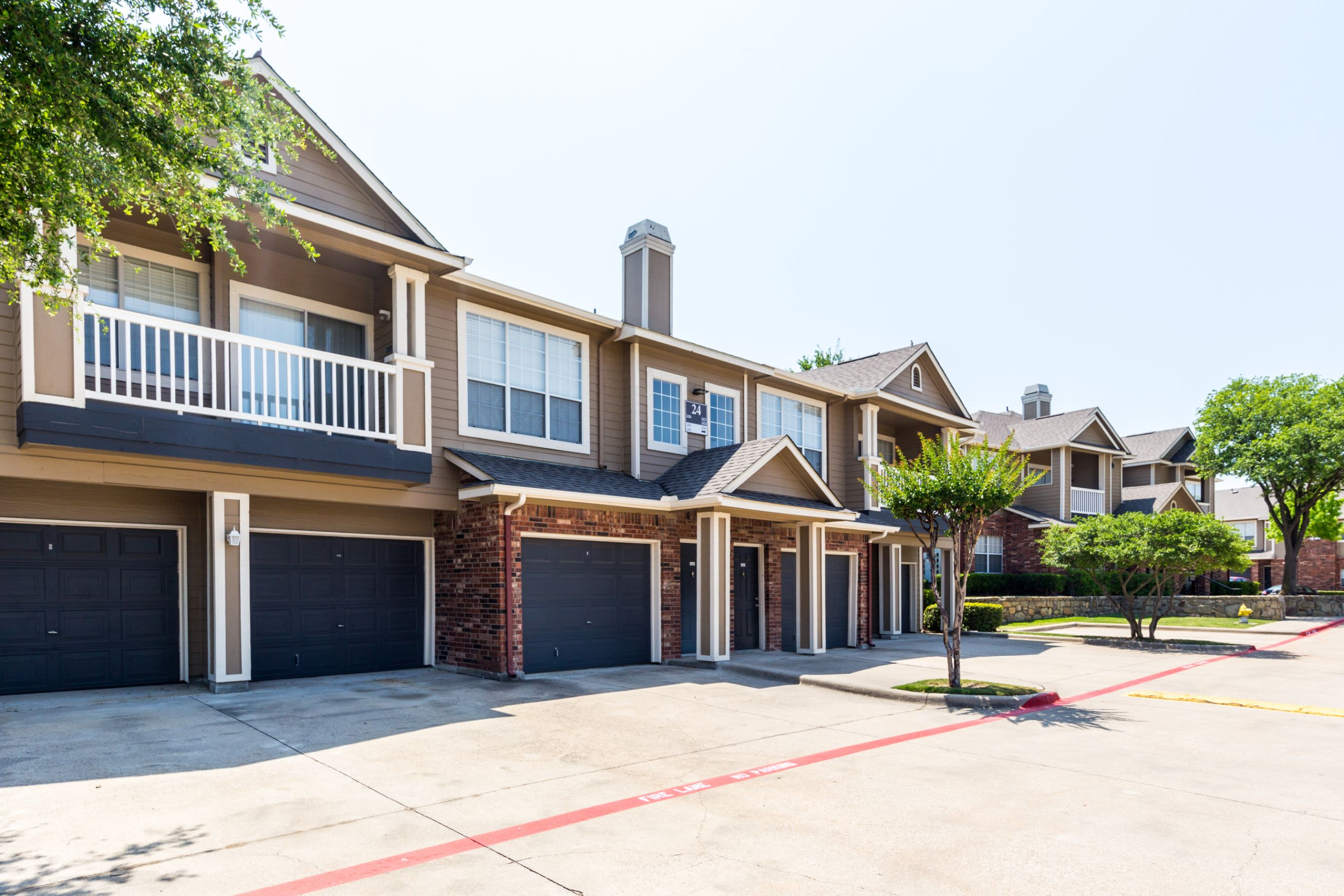 Exterior of units with garages at Marquis at Stonebriar in Frisco, Texas