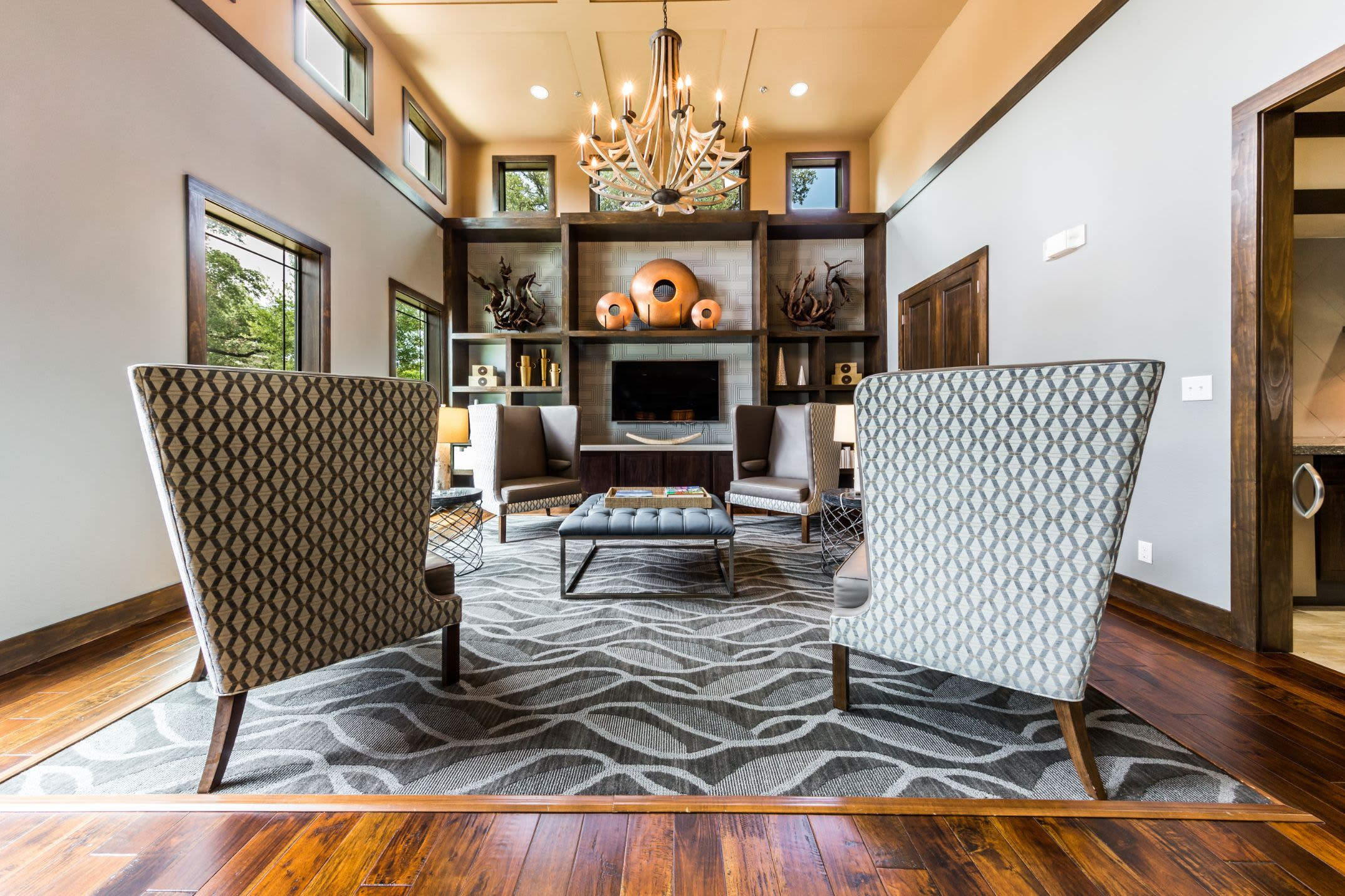 Sitting area with a large rug and a fireplace at Marquis on Lakeline in Cedar Park, Texas