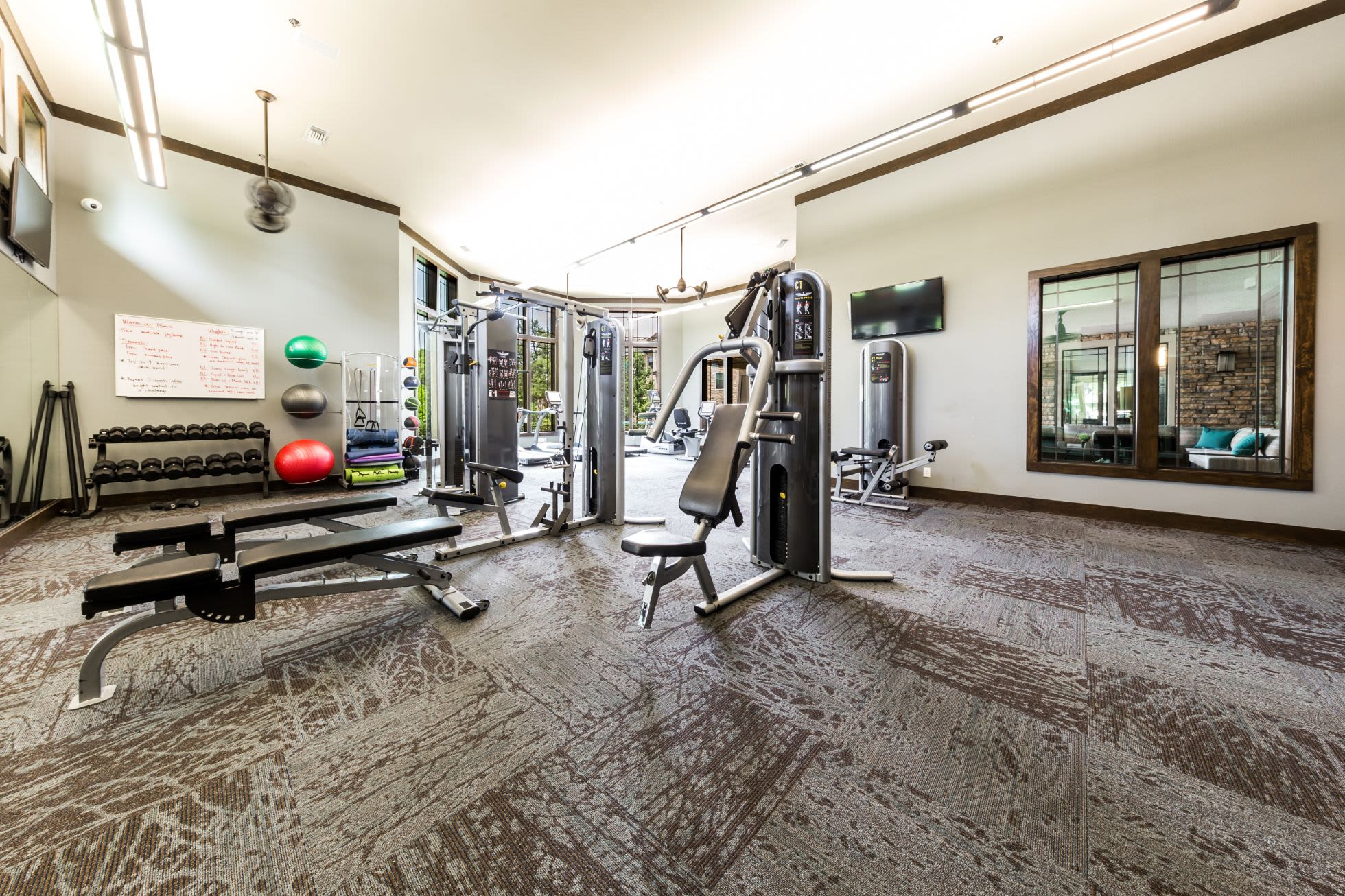 Weight machines and benches in the fitness center at Marquis on Lakeline in Cedar Park, Texas