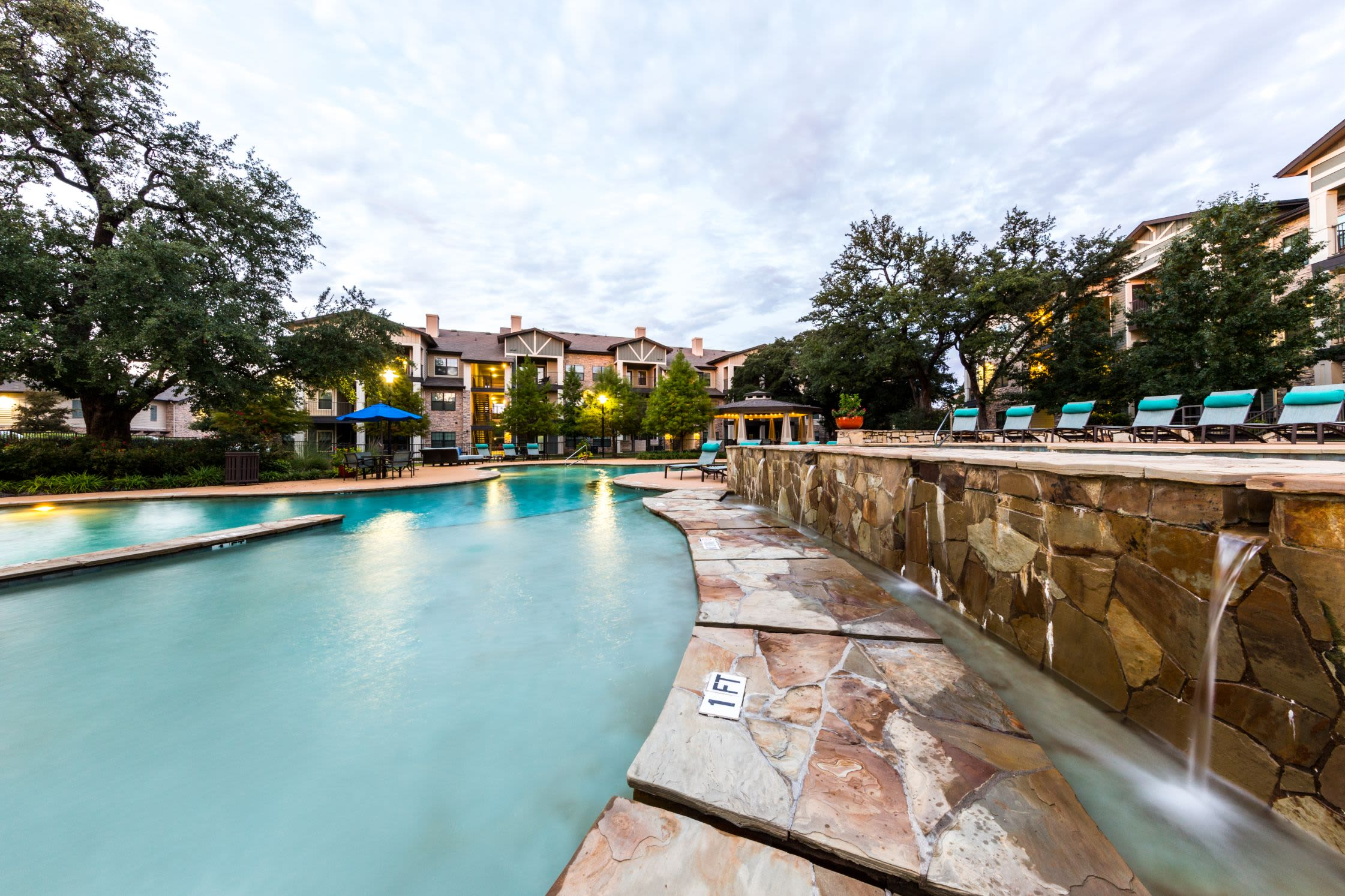 Swimming pool with a water feature at Marquis on Lakeline in Cedar Park, Texas
