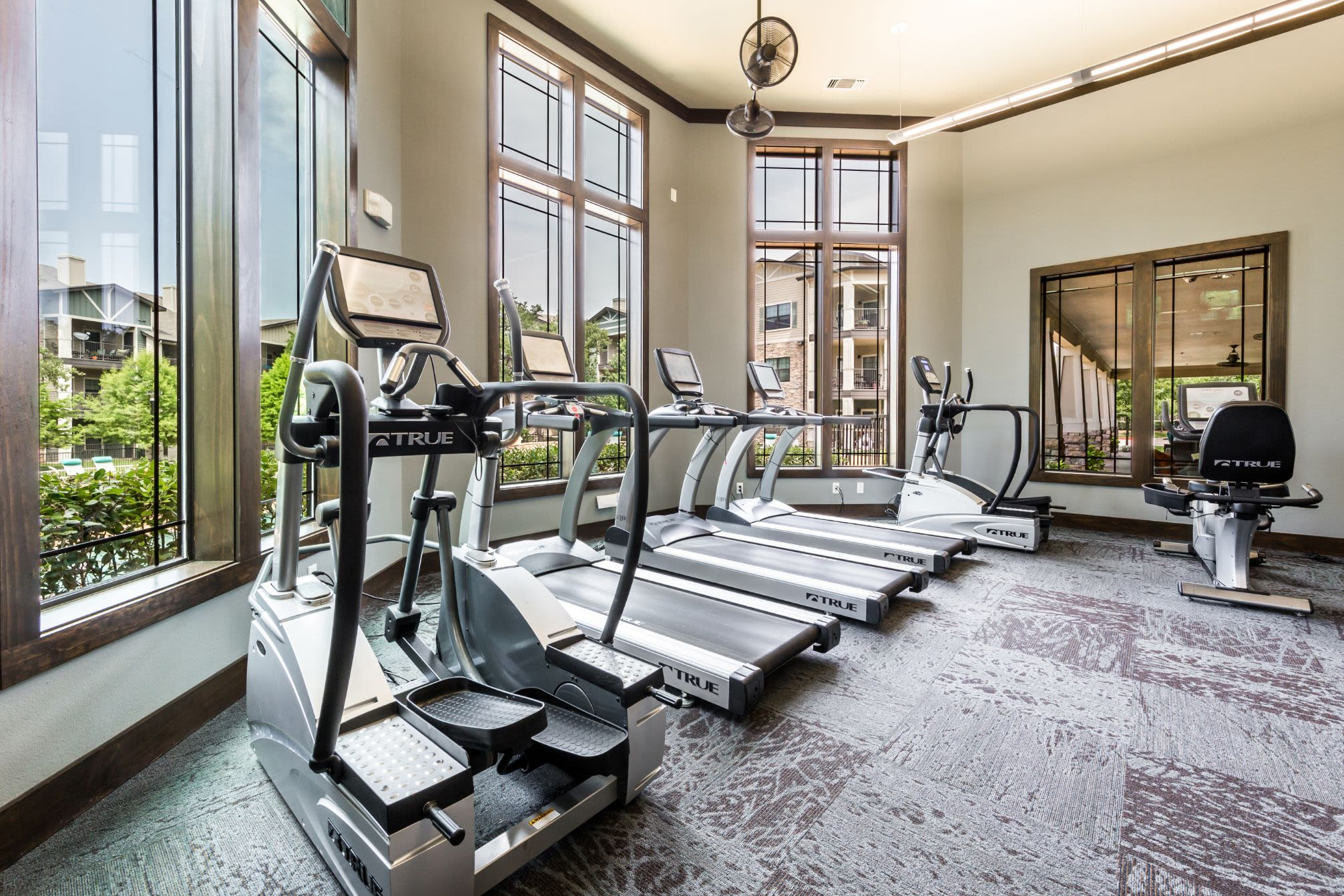 Treadmills in a bright fitness center at Marquis on Lakeline in Cedar Park, Texas