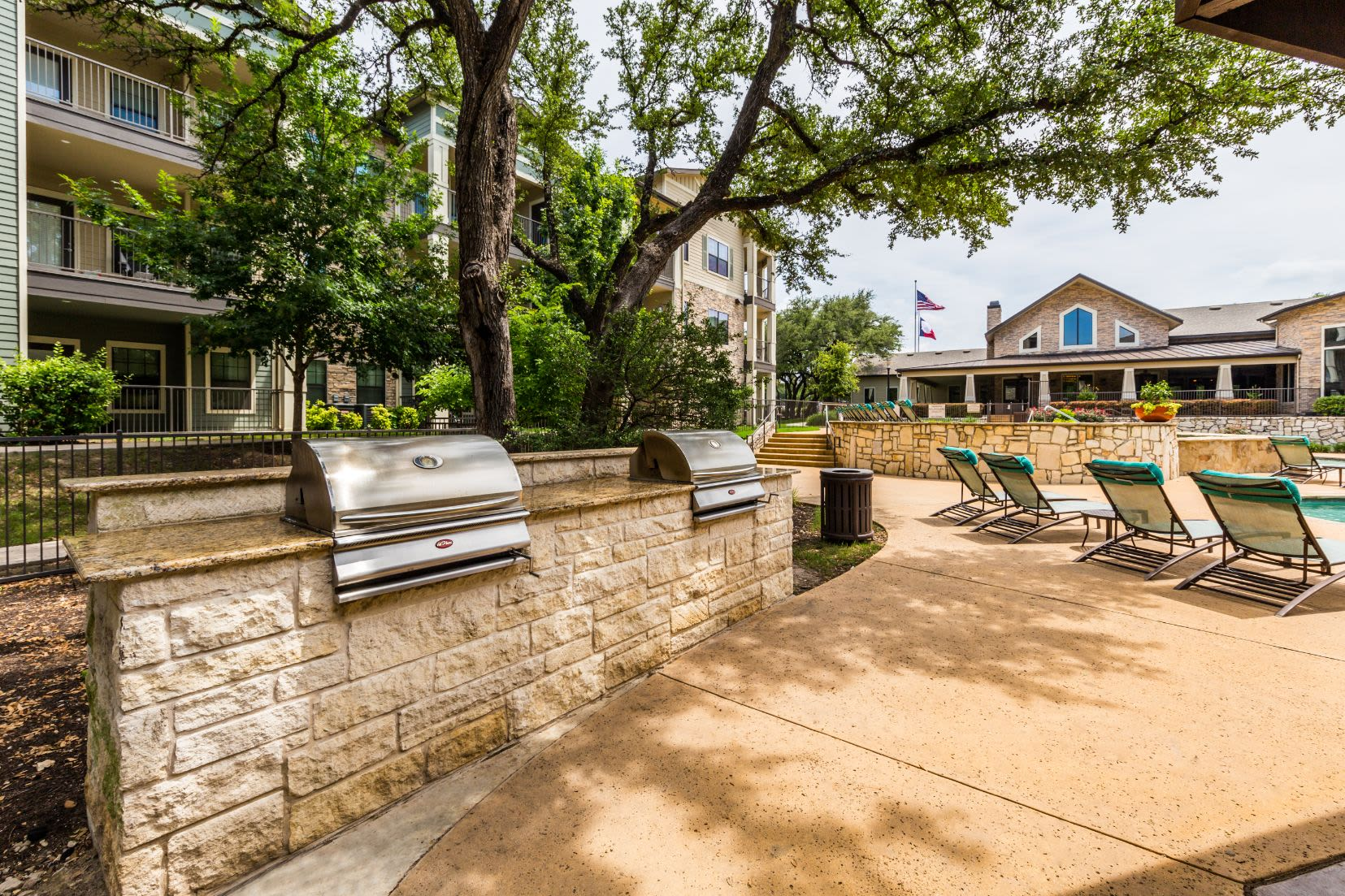 Community grills next to the pool at Marquis on Lakeline in Cedar Park, Texas