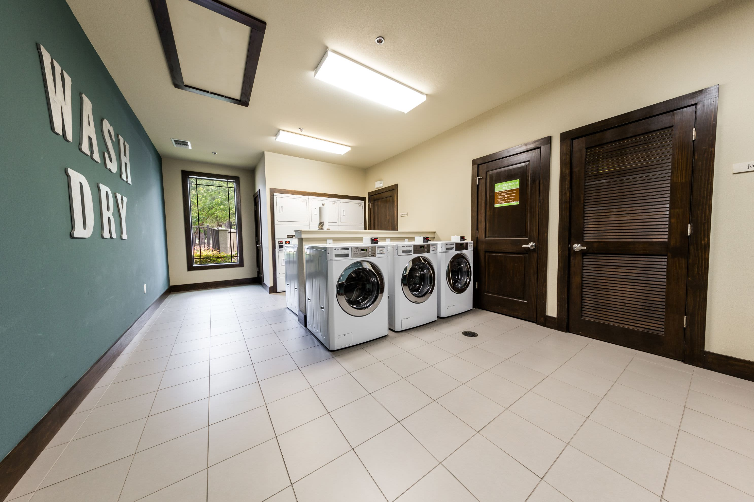 Laundry room at Marquis on Lakeline in Cedar Park, Texas