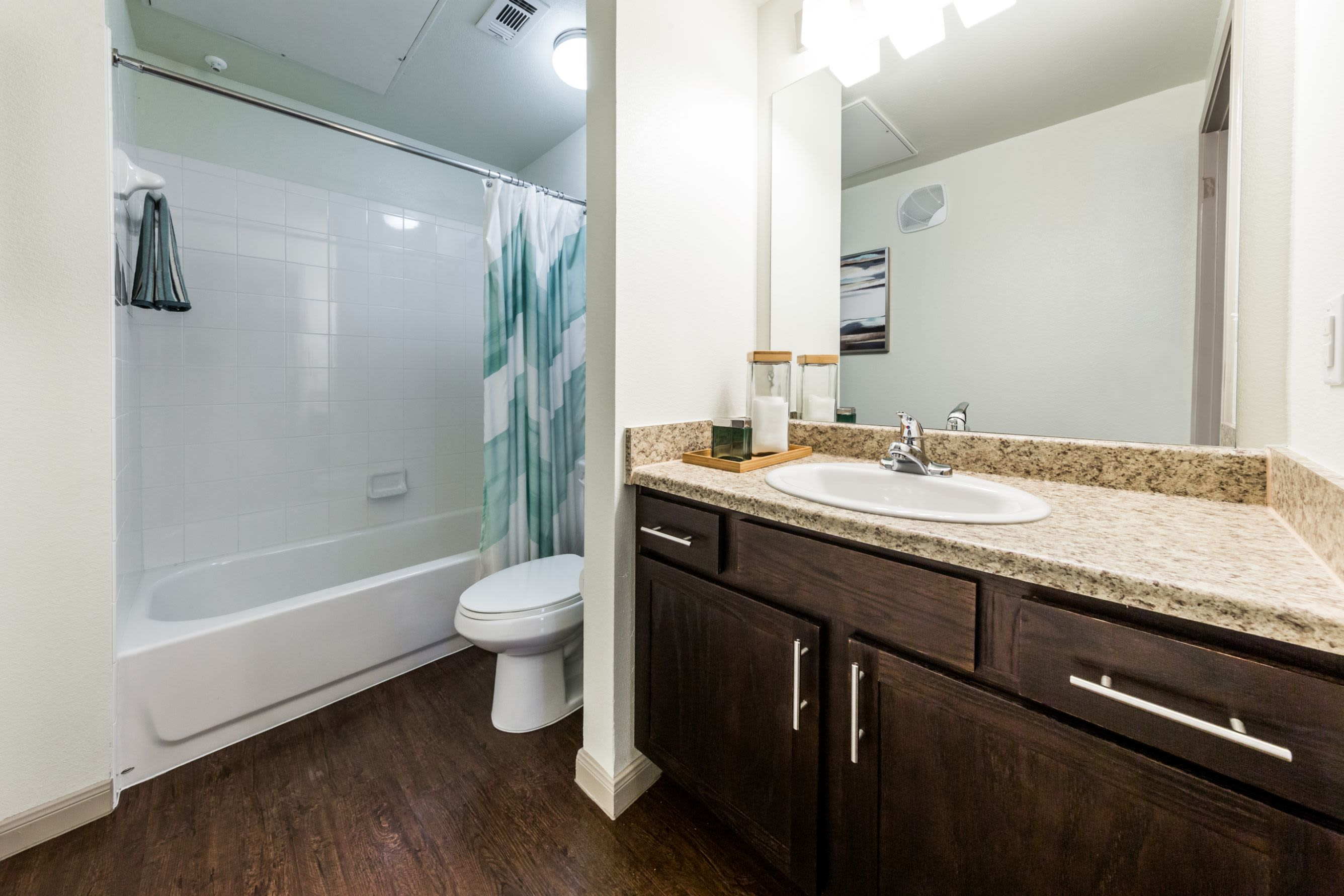 Bathroom with dark colored cabinets at Marquis on Lakeline in Cedar Park, Texas