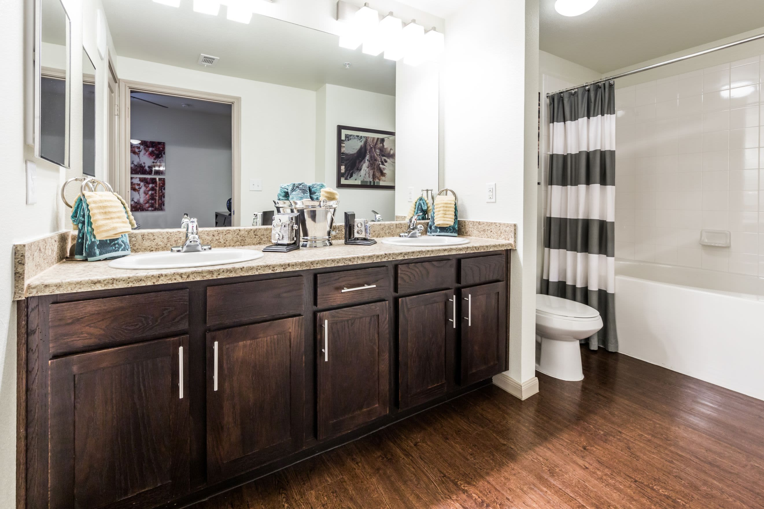 Bathroom with double sinks at Marquis on Lakeline in Cedar Park, Texas