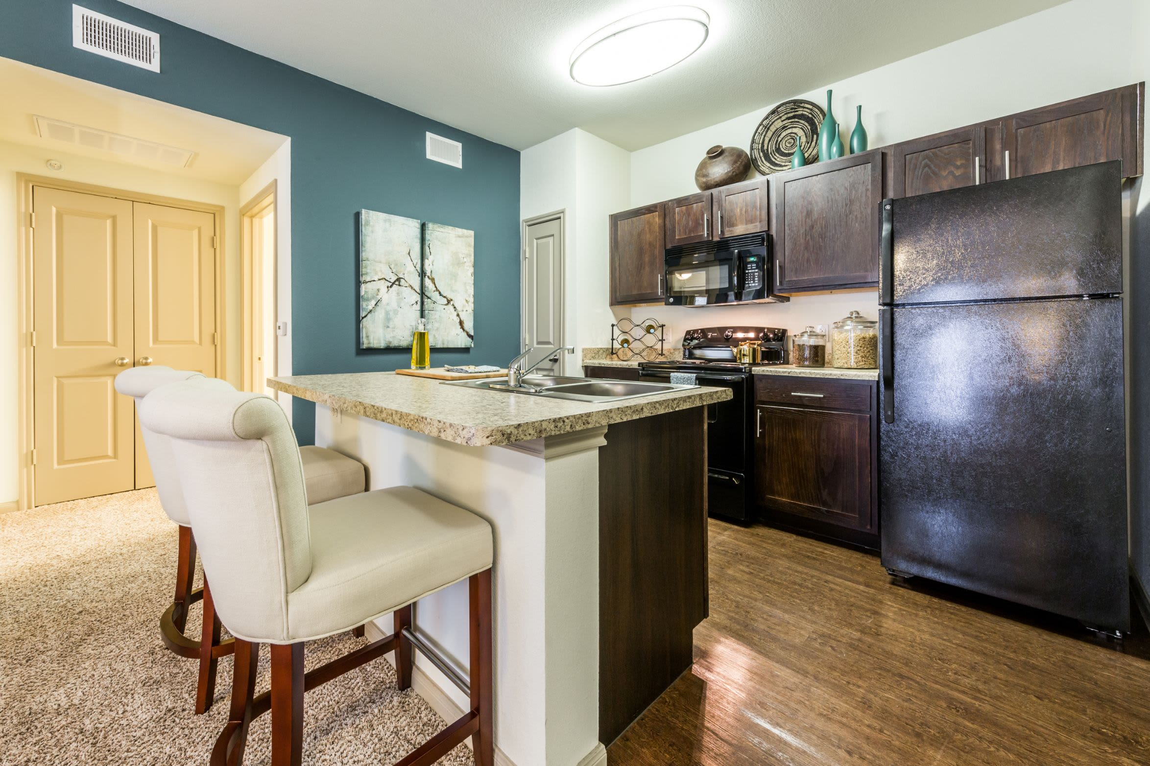Modern kitchen with a breakfast bar at Marquis on Lakeline in Cedar Park, Texas