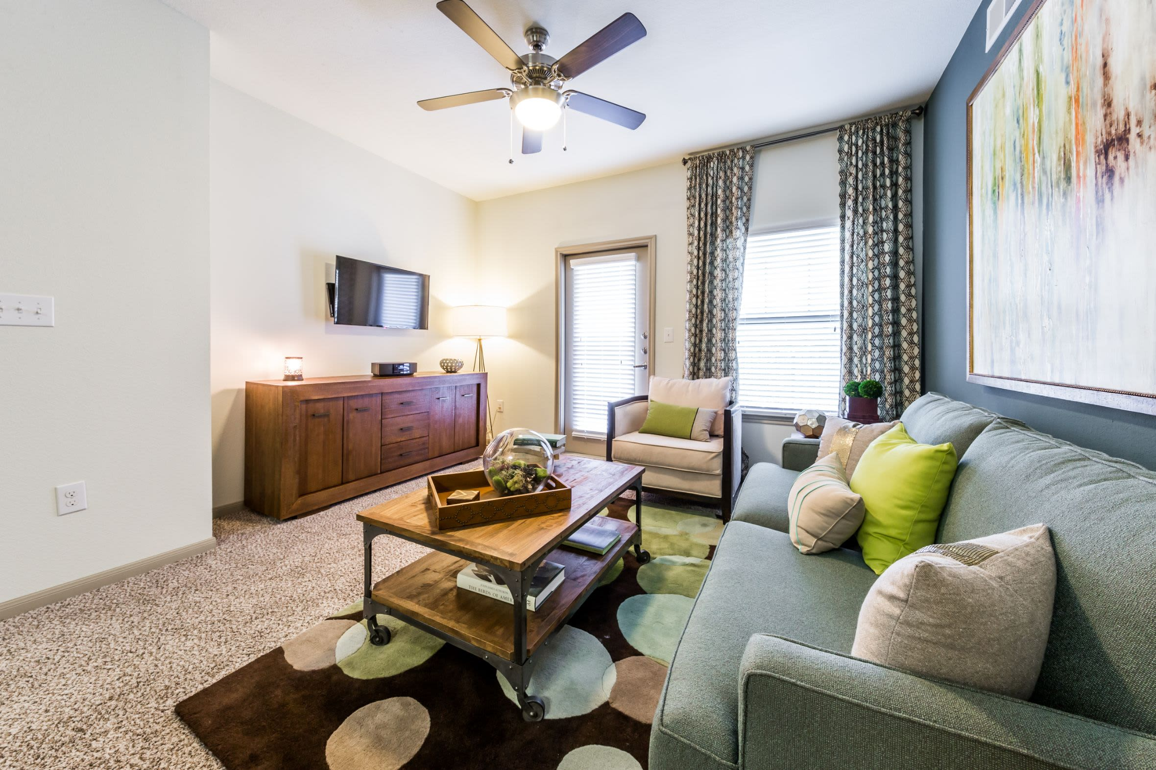 Living room with carpet floors and a ceiling fan at Marquis on Lakeline in Cedar Park, Texas