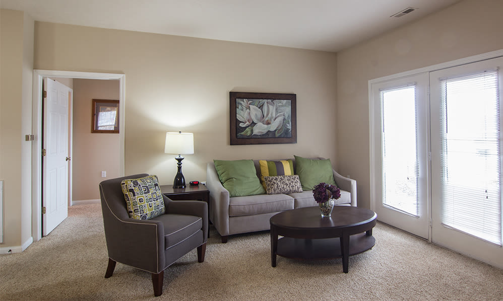 Naturally well-lit living room at Avalon at Northbrook Apartments & Townhomes in Fort Wayne, Indiana