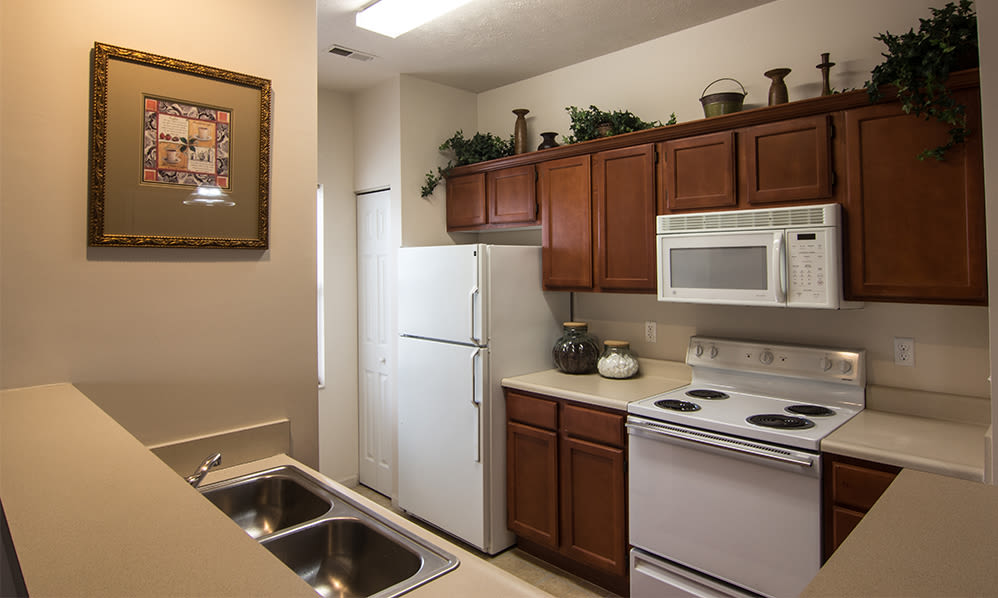 Fully-equipped kitchen at Avalon at Northbrook Apartments & Townhomes in Fort Wayne, Indiana