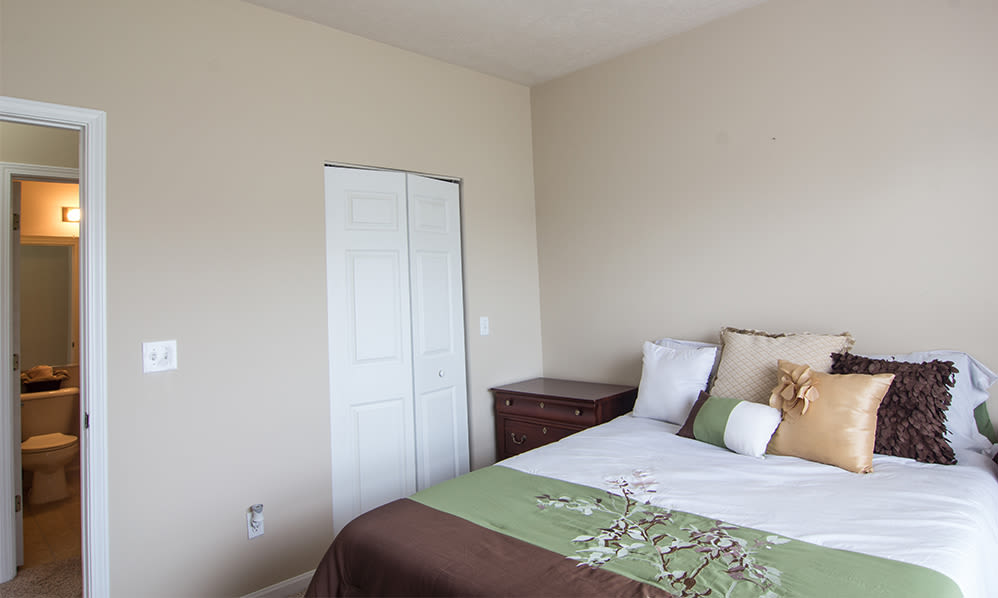 Cozy bedroom at Avalon at Northbrook Apartments & Townhomes in Fort Wayne, Indiana