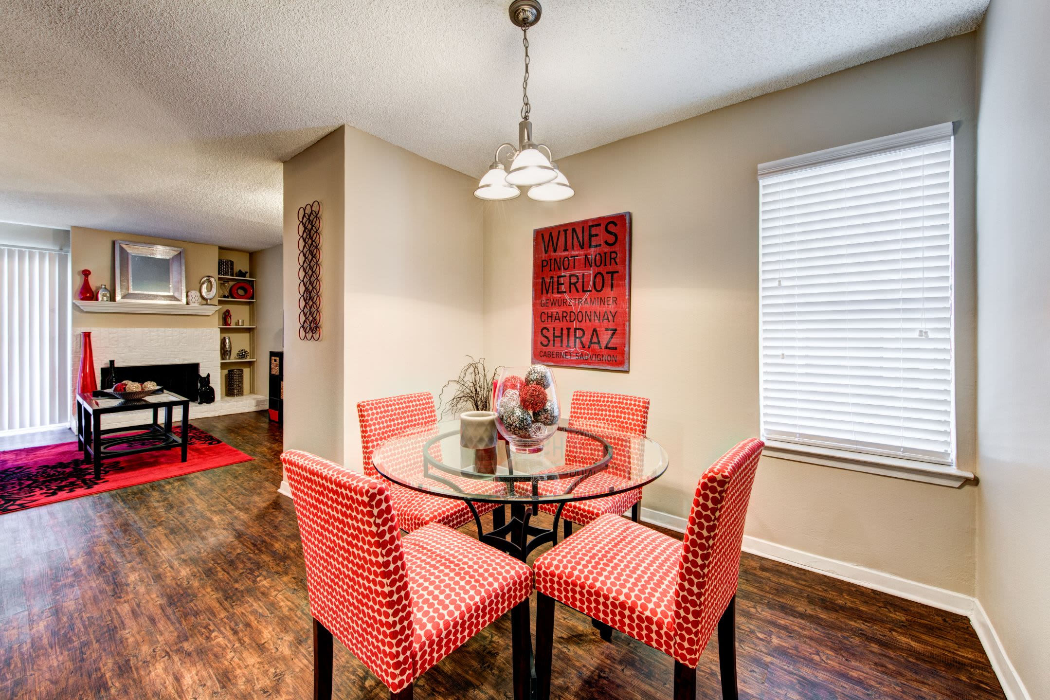 Dining area with a small chandelier at The Park at Flower Mound in Flower Mound, Texas