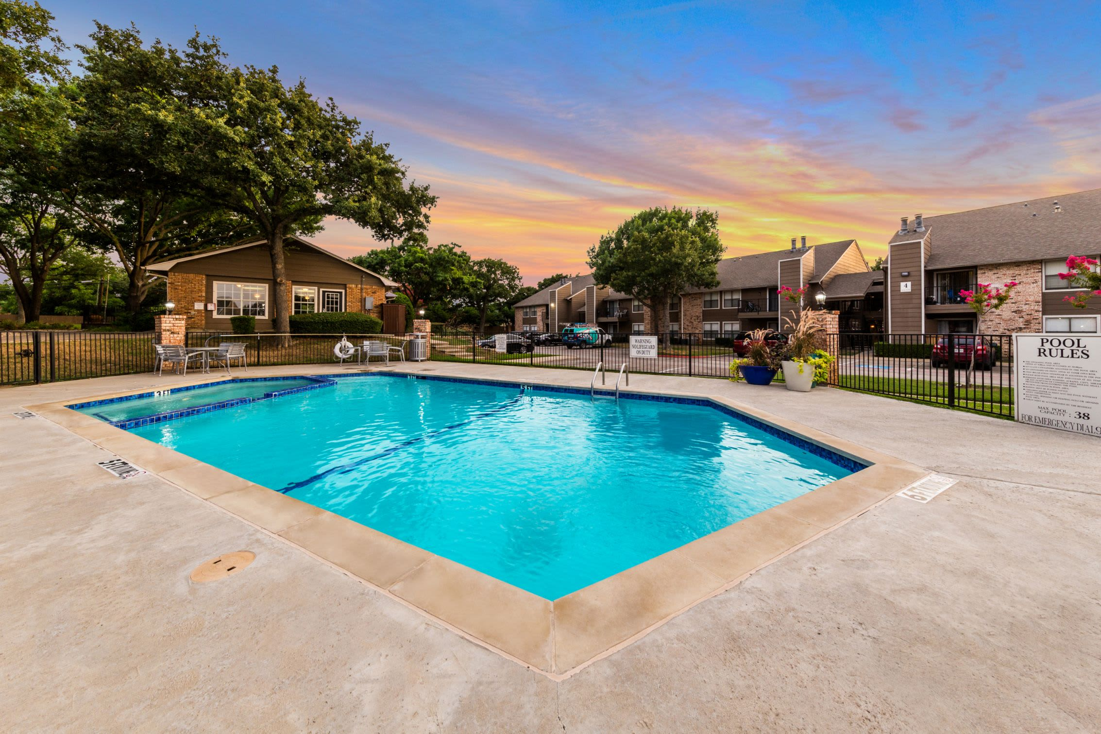 Sparkling pool with units in the background at The Park at Flower Mound in Flower Mound, Texas