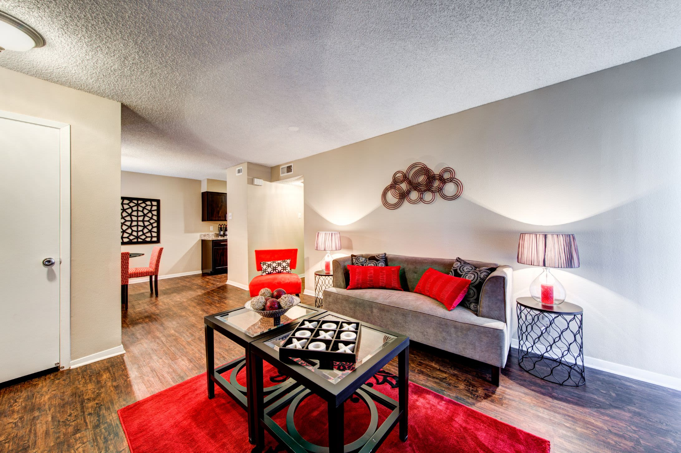 Bright living room with a large rug at The Park at Flower Mound in Flower Mound, Texas