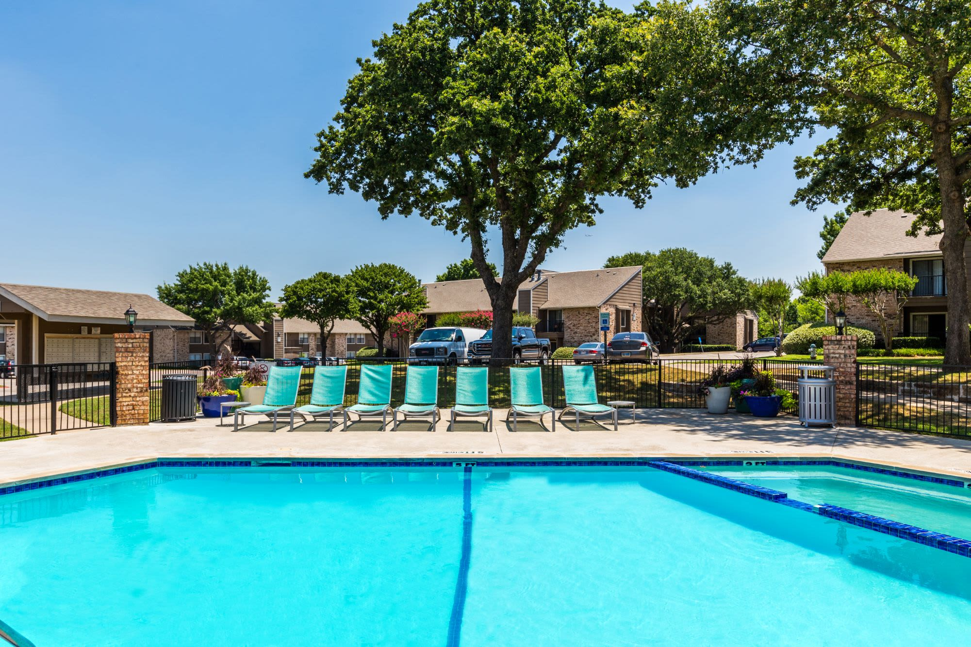 Sparkling pool with sun chairs at The Park at Flower Mound in Flower Mound, Texas