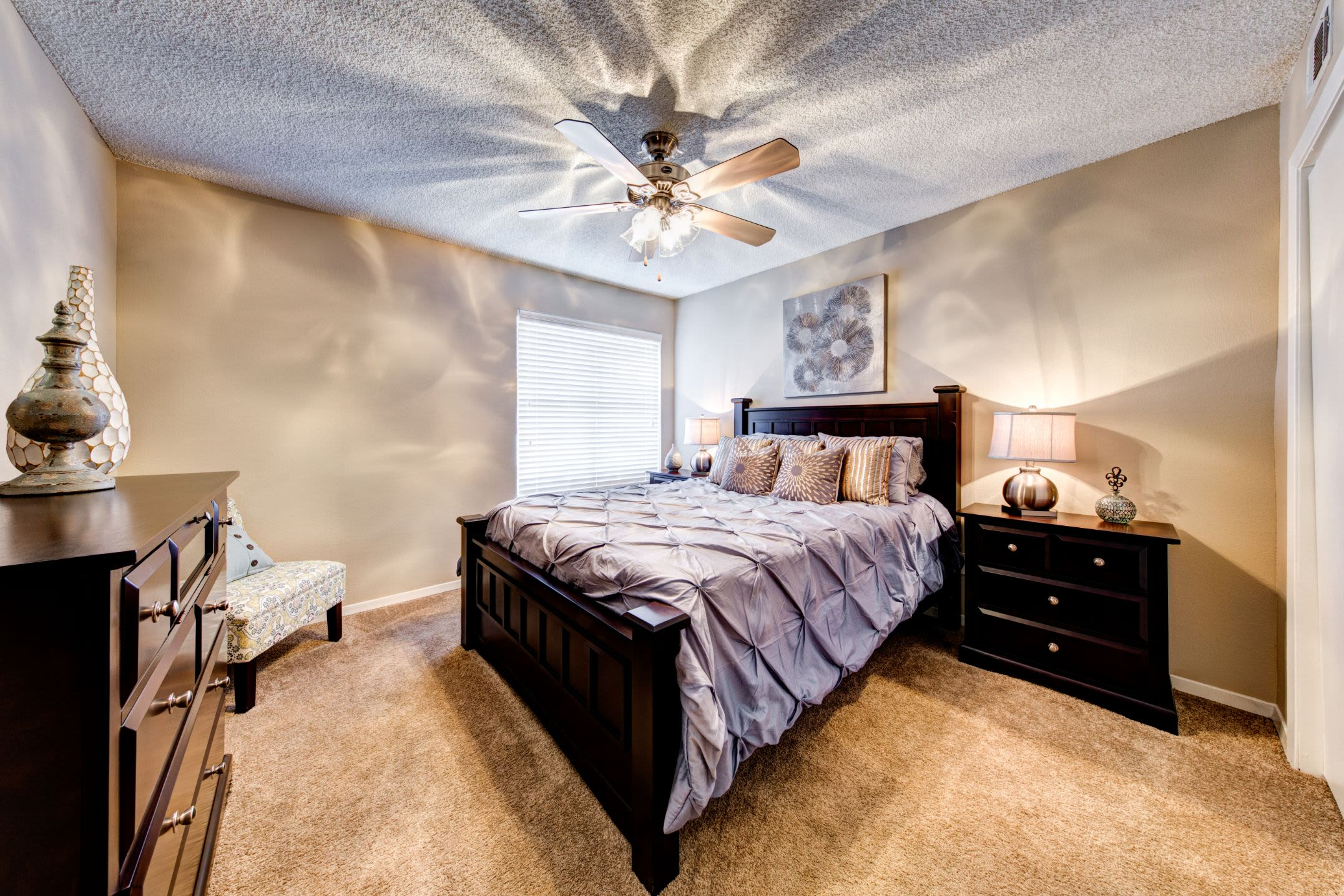 Bedroom with a ceiling fan at The Park at Flower Mound in Flower Mound, Texas