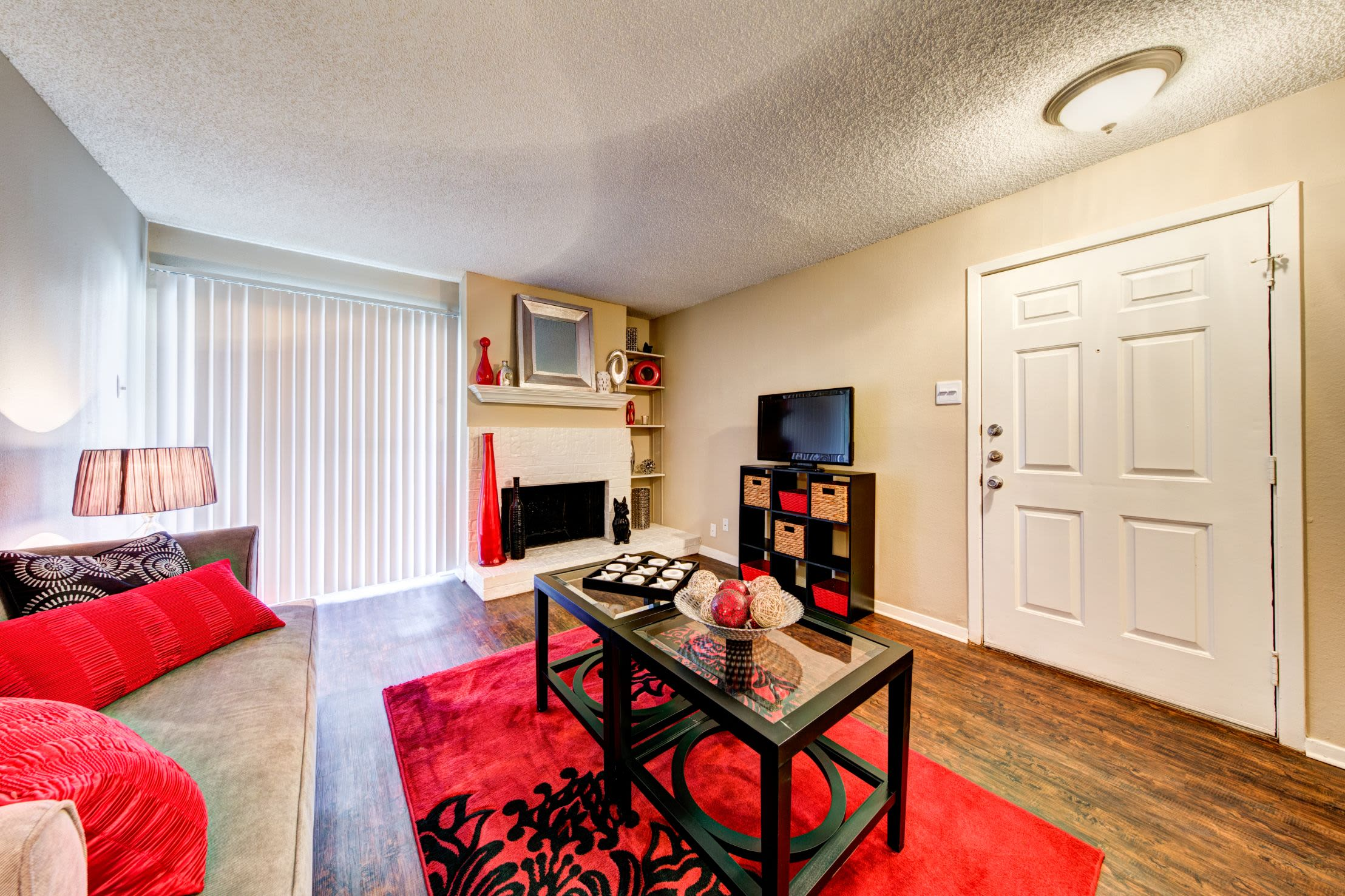 Bright living room with a fireplace at The Park at Flower Mound in Flower Mound, Texas