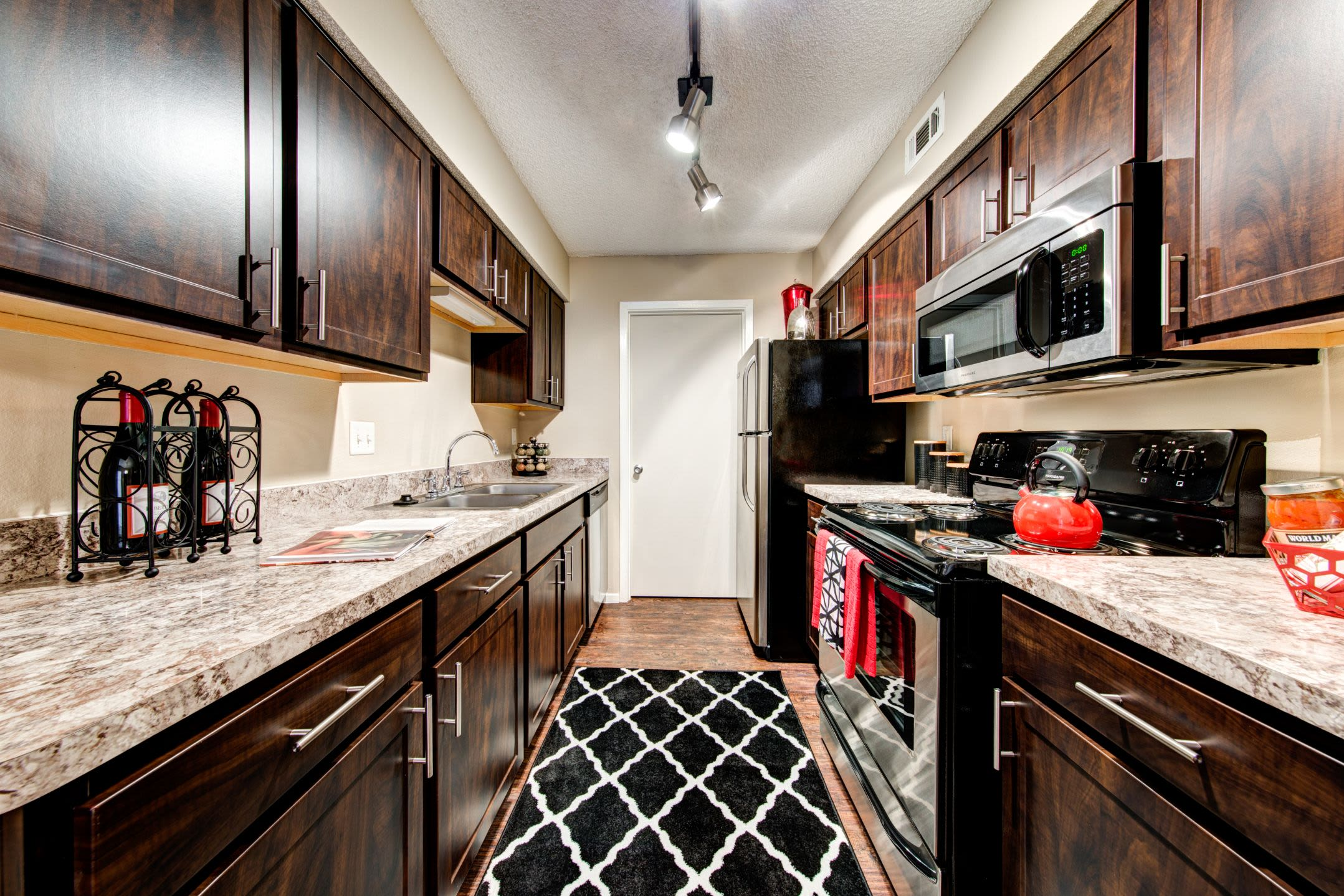 Modern kitchen with dark colored cabinets at The Park at Flower Mound in Flower Mound, Texas