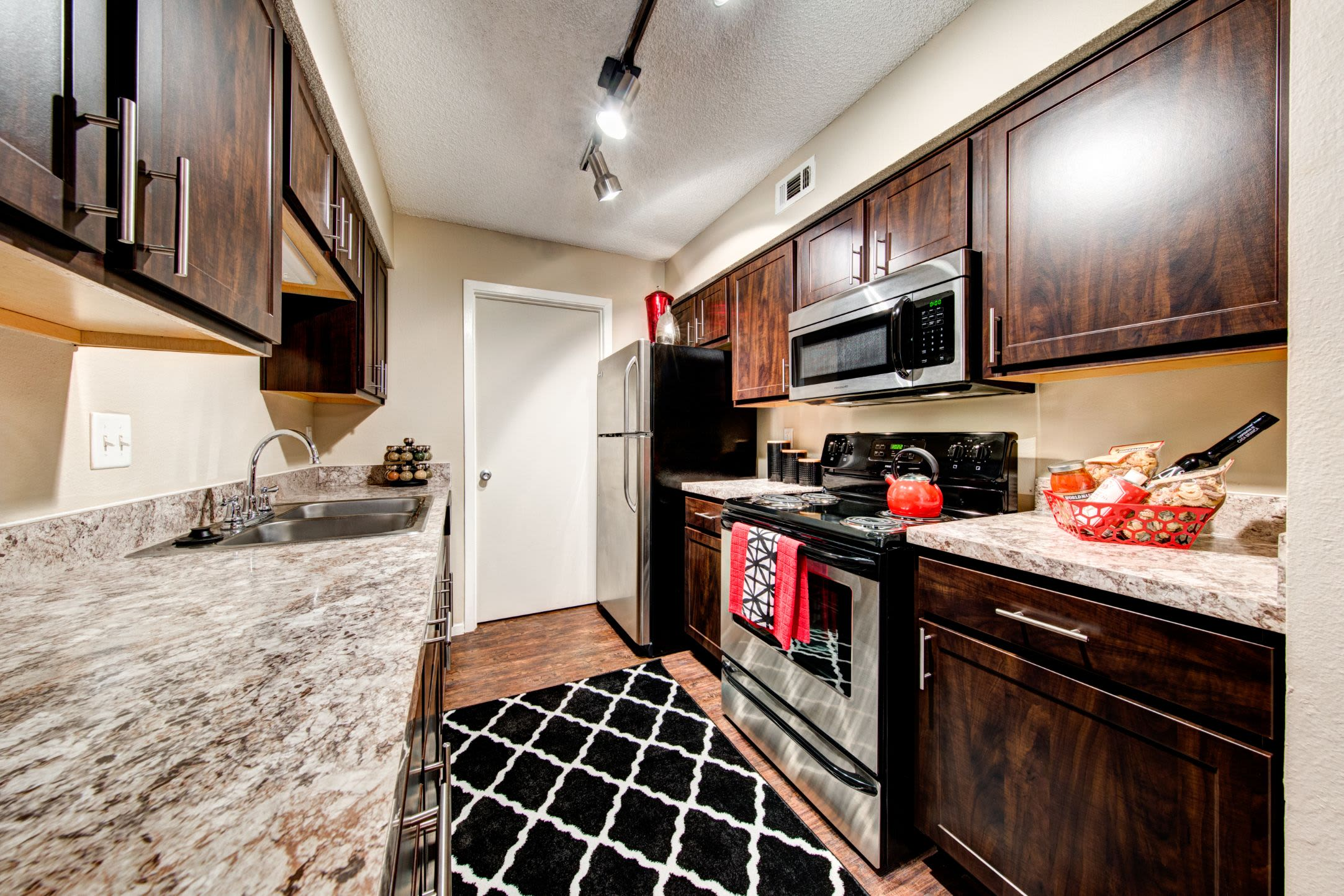 Bright kitchen with a rug at The Park at Flower Mound in Flower Mound, Texas