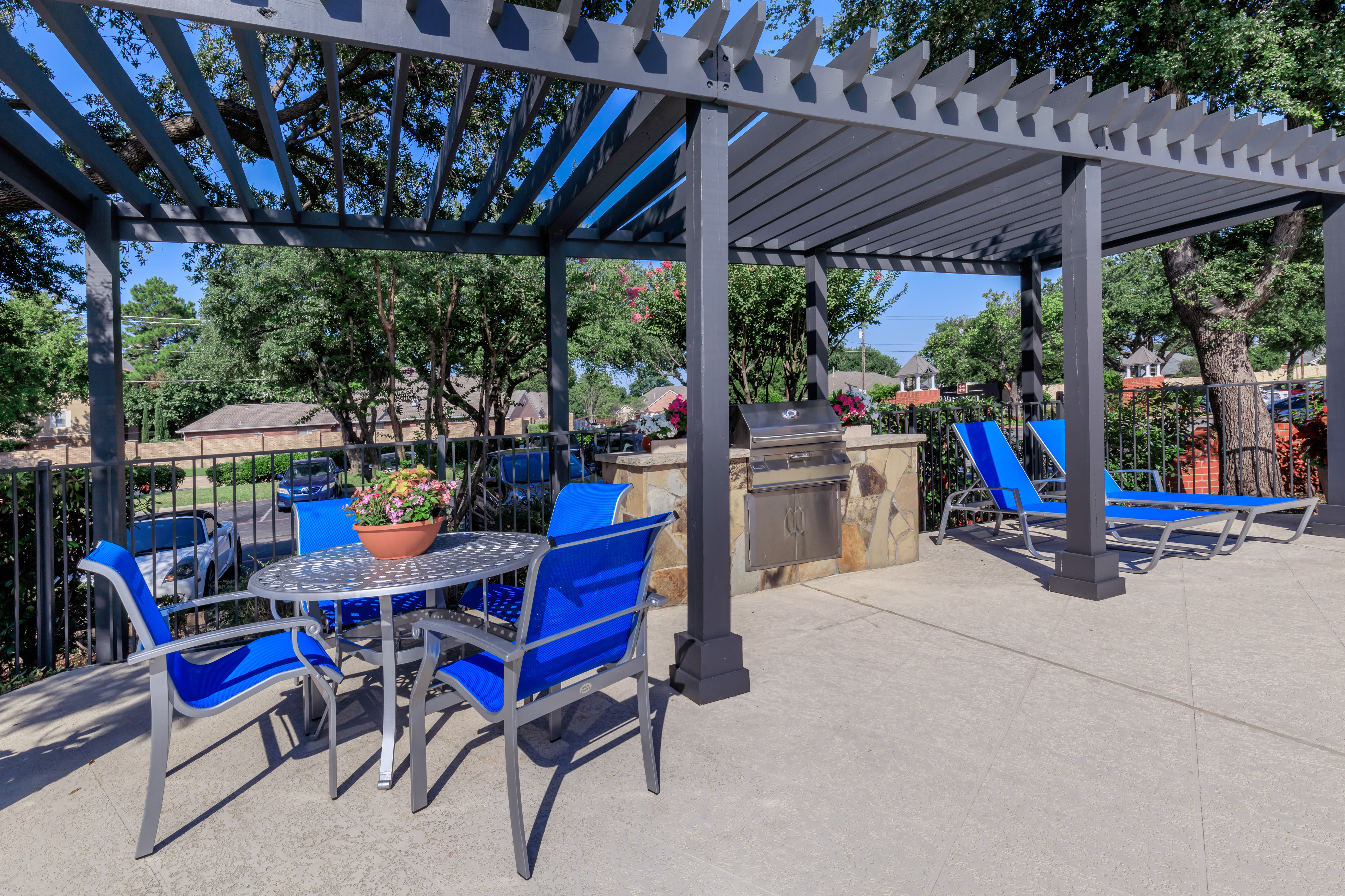 Poolside seating at Windmill Terrace in Bedford, Texas
