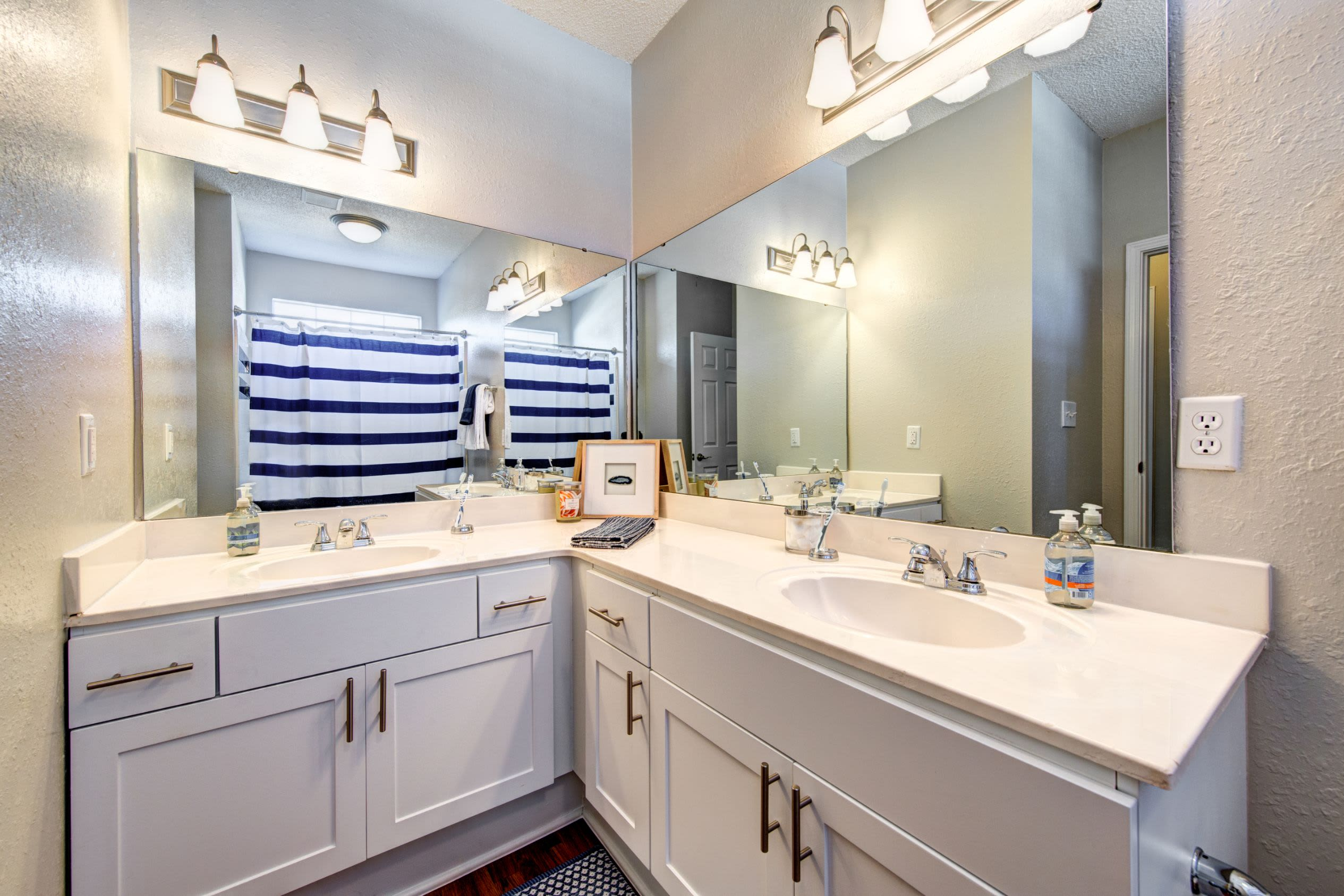 Bathroom with a large vanity at Marquis on Edwards Mill in Raleigh, North Carolina