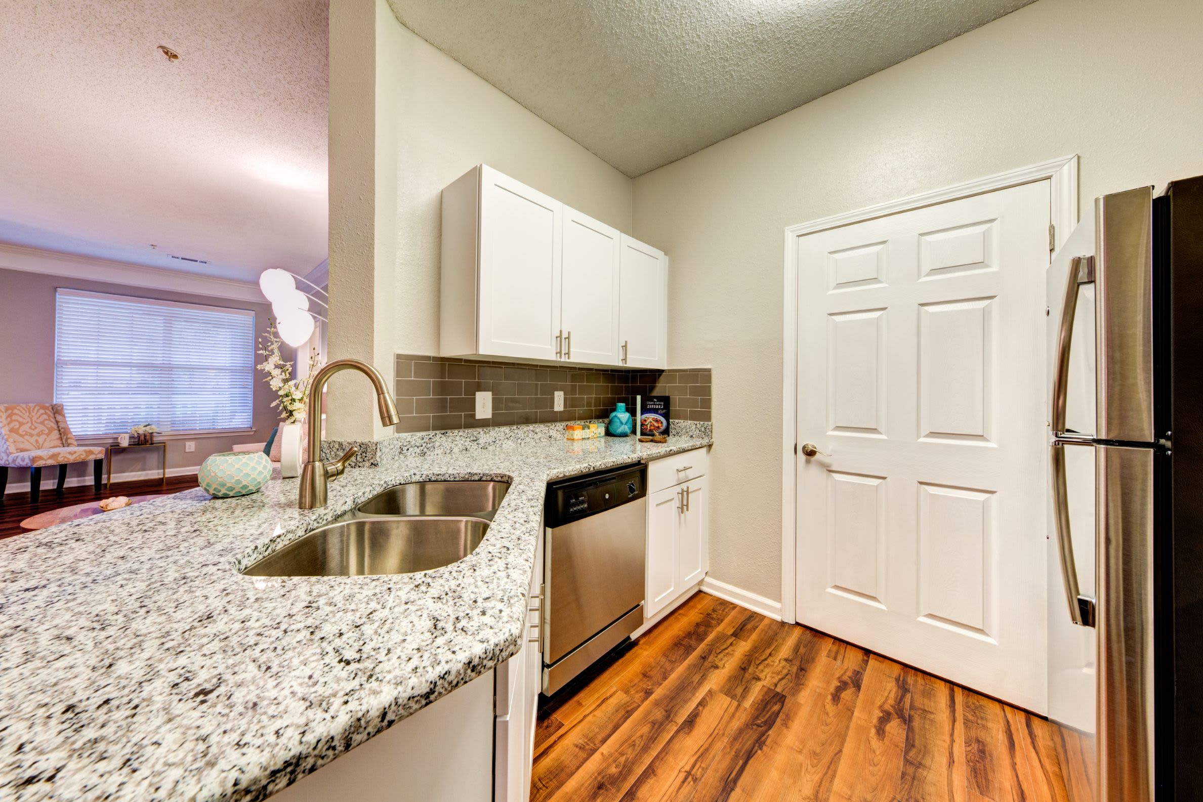 Kitchen wit granite counters and white cabinets at Marquis on Edwards Mill in Raleigh, North Carolina