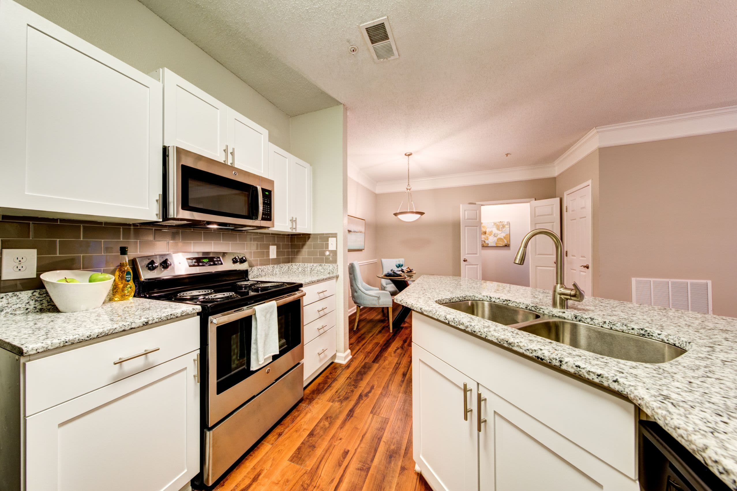 Bright kitchen with wood floors at Marquis on Edwards Mill in Raleigh, North Carolina