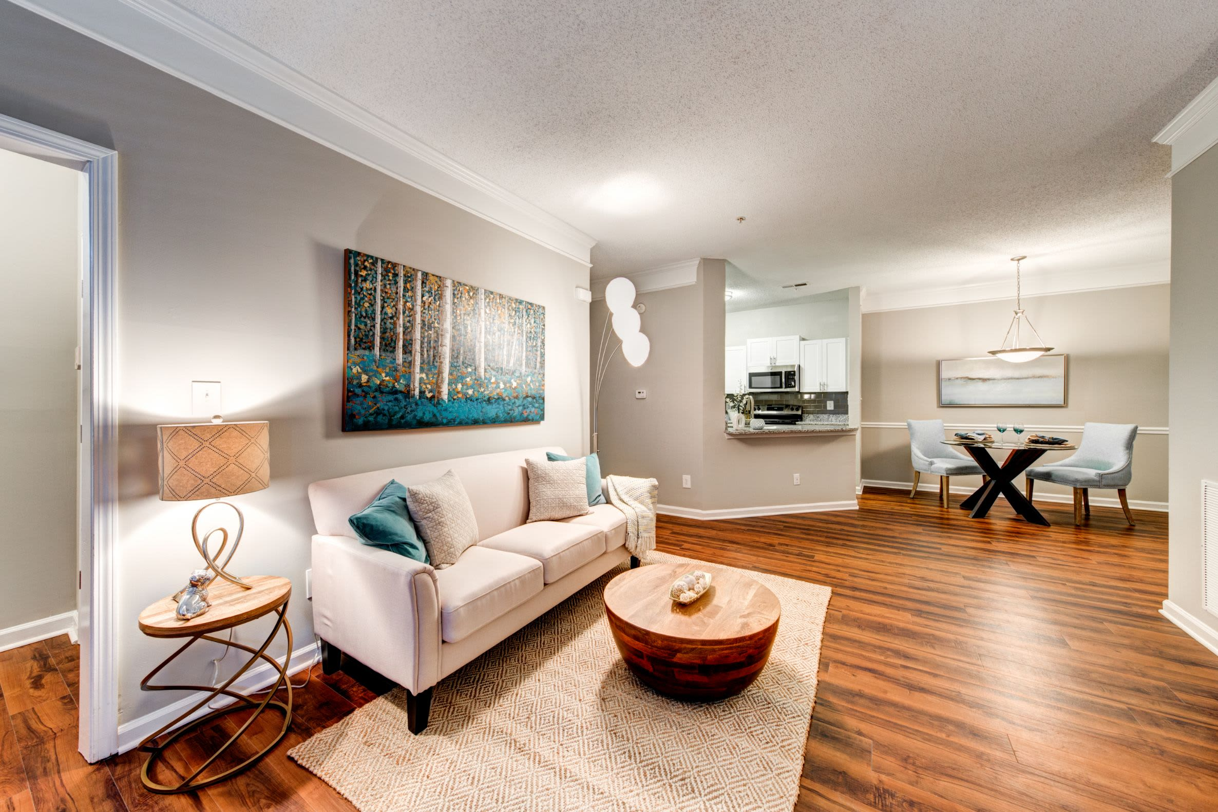 Bright and open living room at Marquis on Edwards Mill in Raleigh, North Carolina