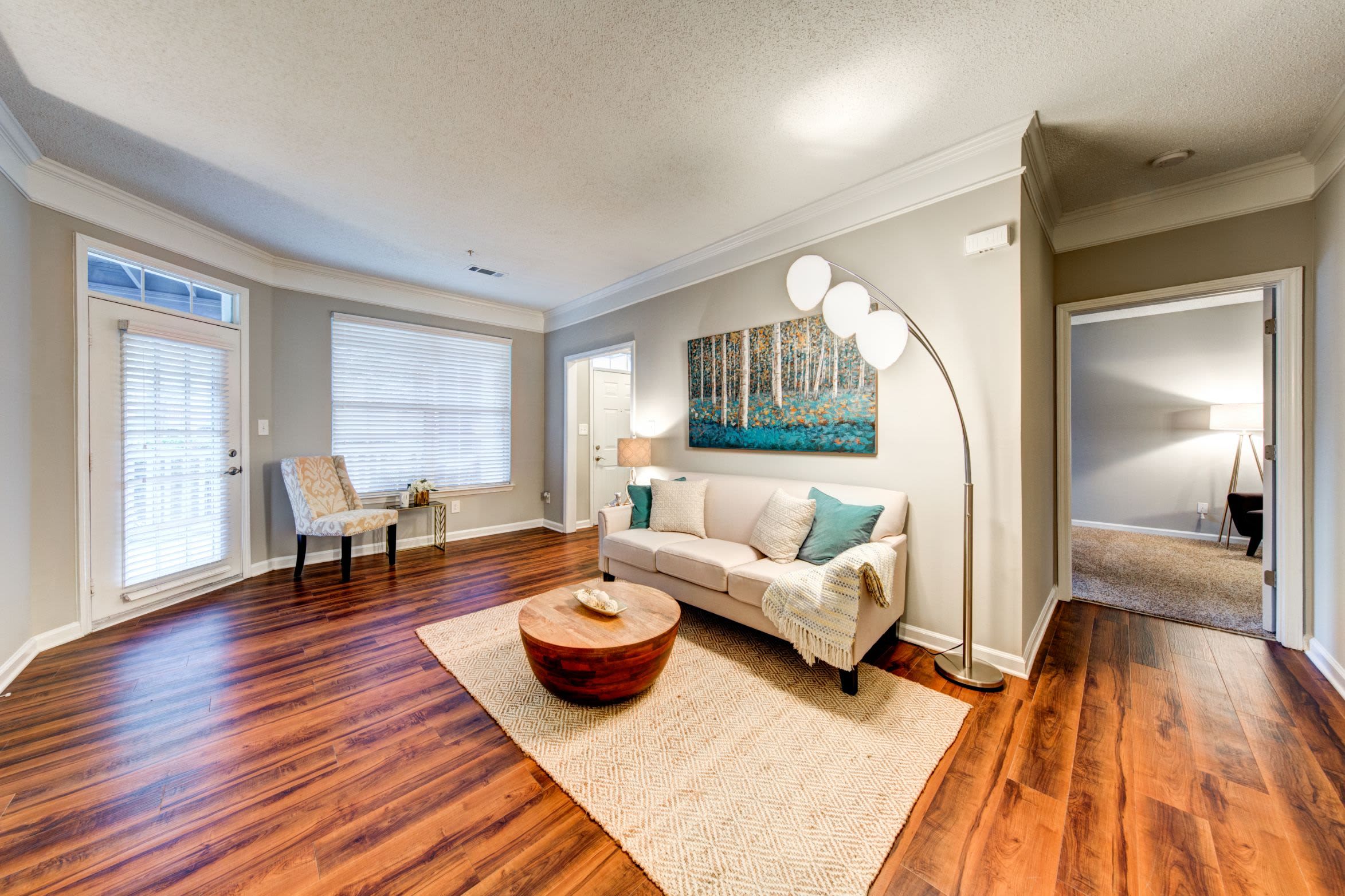 Spacious living area with large windows at Marquis on Edwards Mill in Raleigh, North Carolina