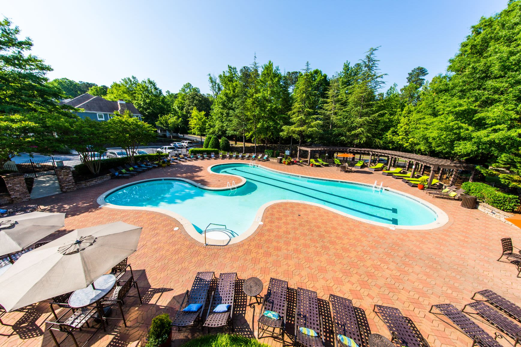 Swimming pool with sun chairs at Marquis on Edwards Mill in Raleigh, North Carolina