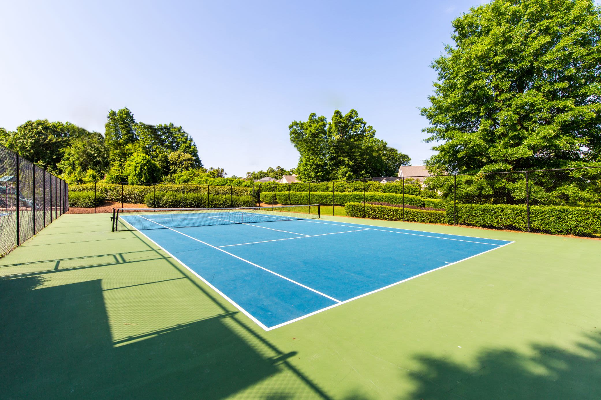 Outdoor tennis court at Marquis on Edwards Mill in Raleigh, North Carolina