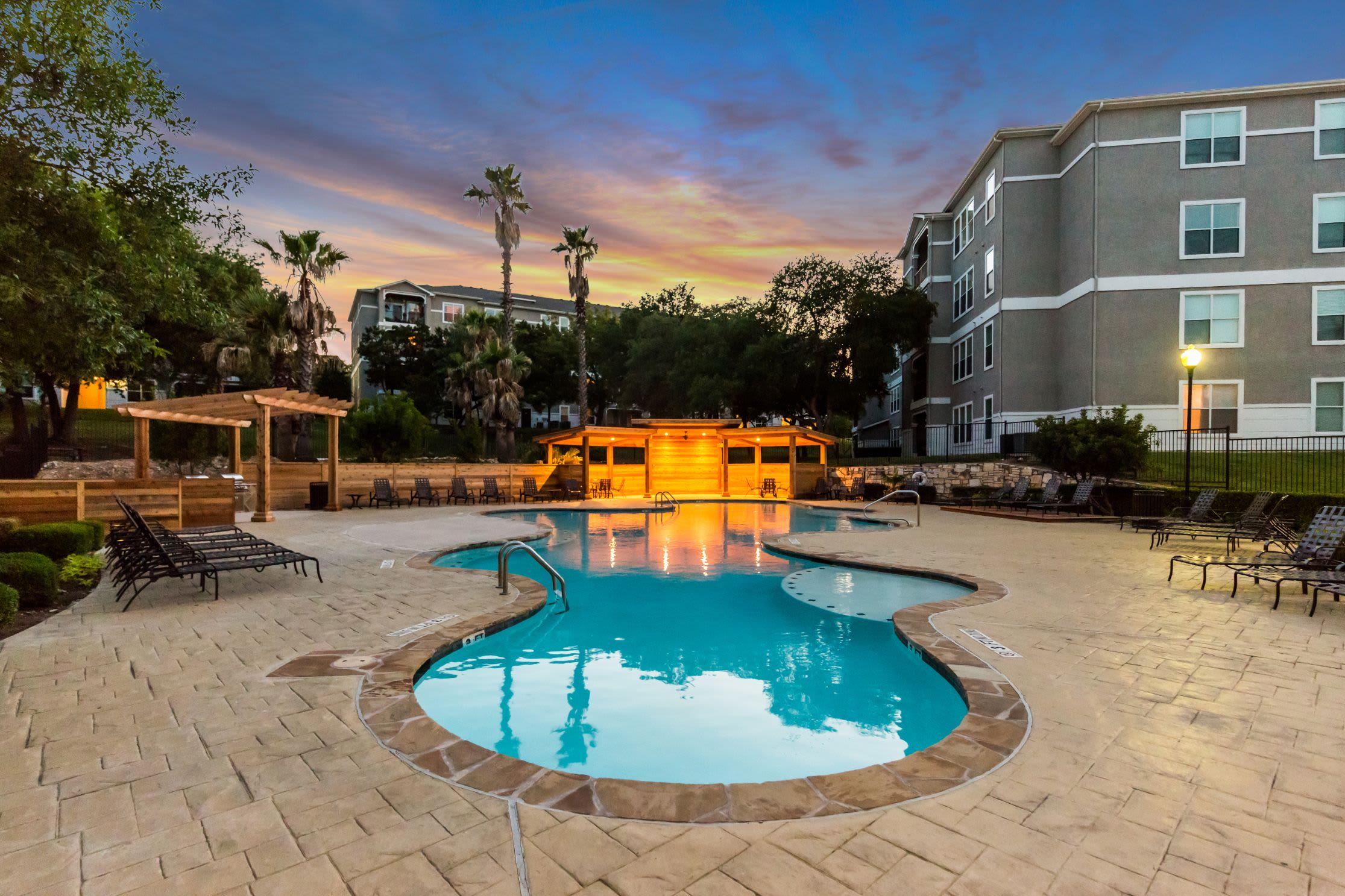 Swimming pool at sunset at Marquis at Crown Ridge in San Antonio, Texas