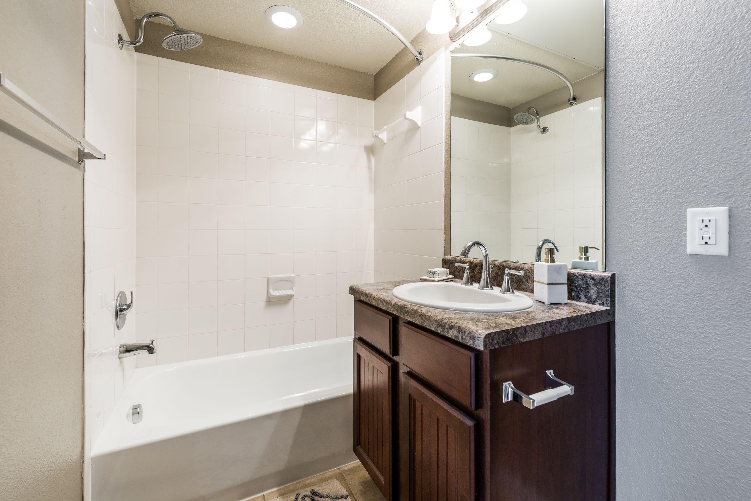 Bright bathroom with a shower tub at Marquis at Crown Ridge in San Antonio, Texas