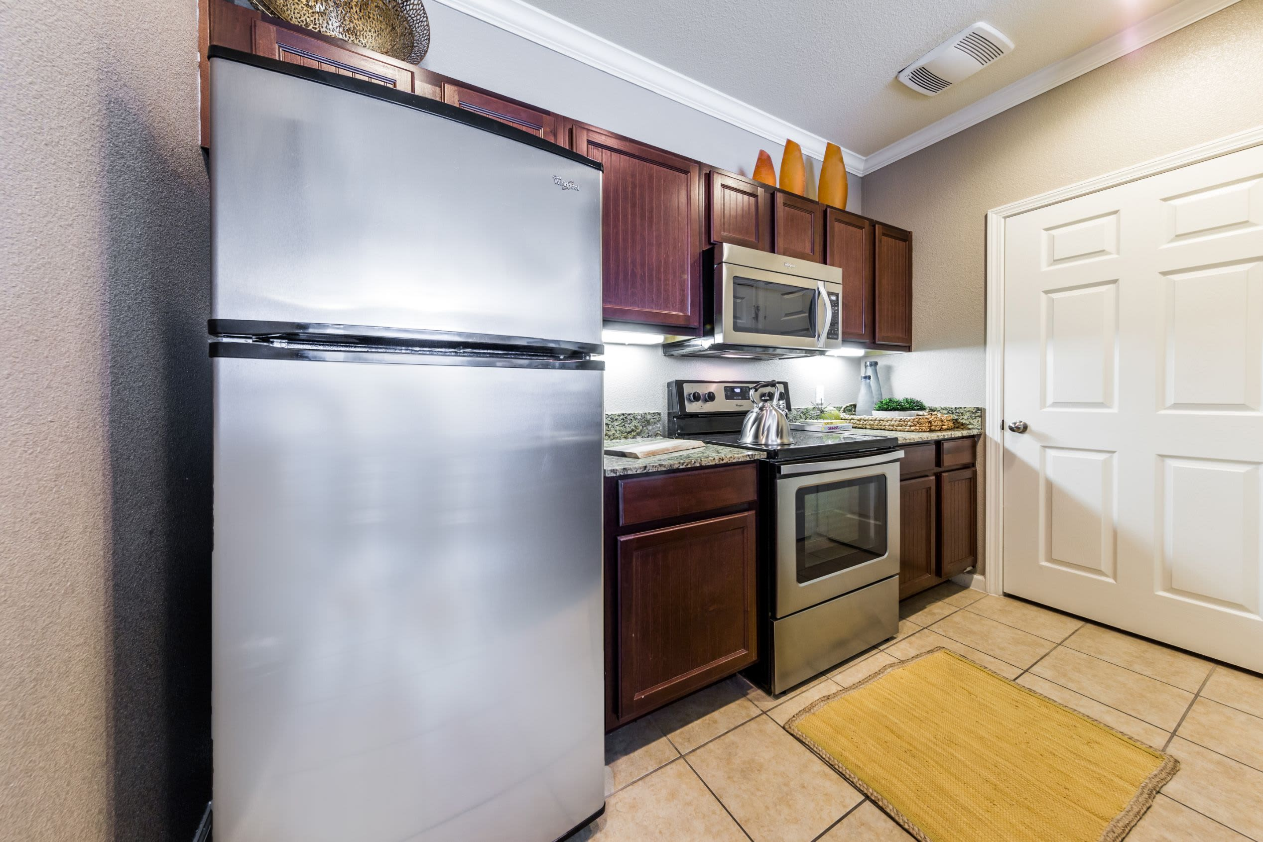 Modern kitchen with dark colored cabinets at Marquis at Crown Ridge in San Antonio, Texas