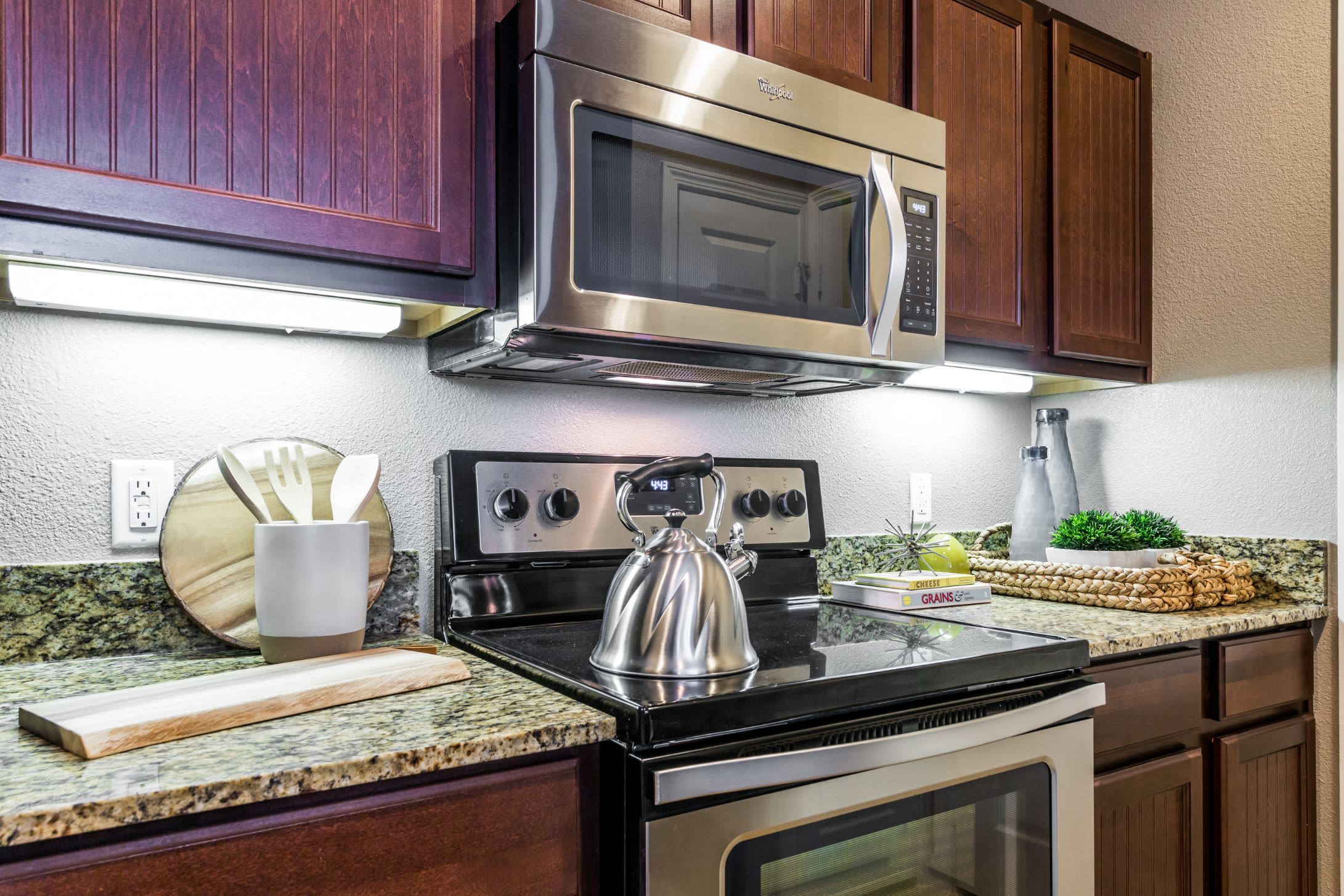 Stainless steel stove and microwave at Marquis at Crown Ridge in San Antonio, Texas