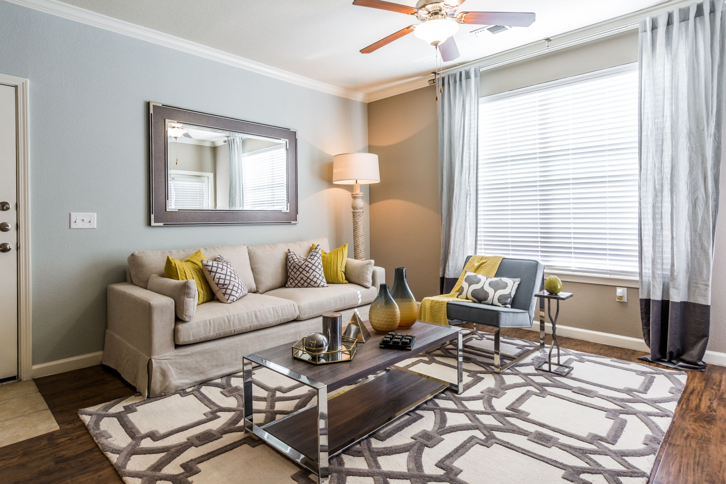Living room with modern furnishings at Marquis at Crown Ridge in San Antonio, Texas
