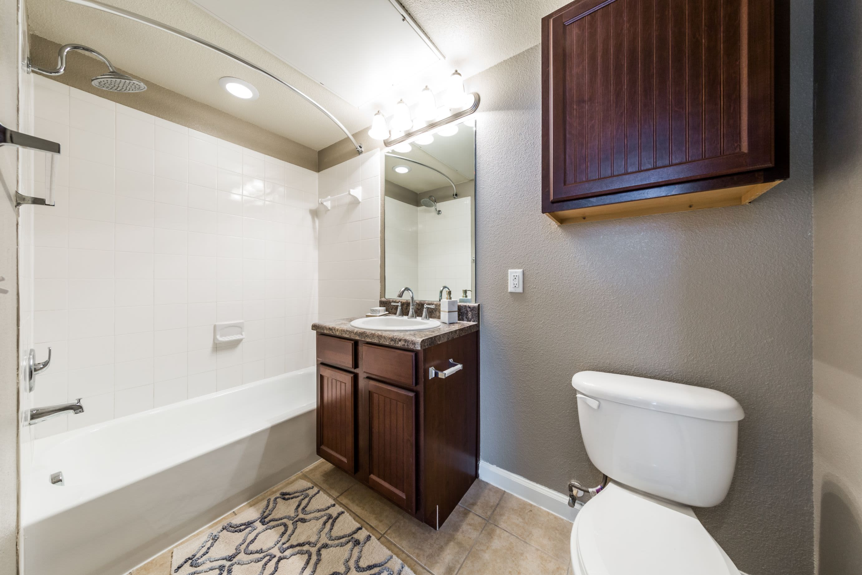 Bathroom with dark colored cabinets at Marquis at Crown Ridge in San Antonio, Texas