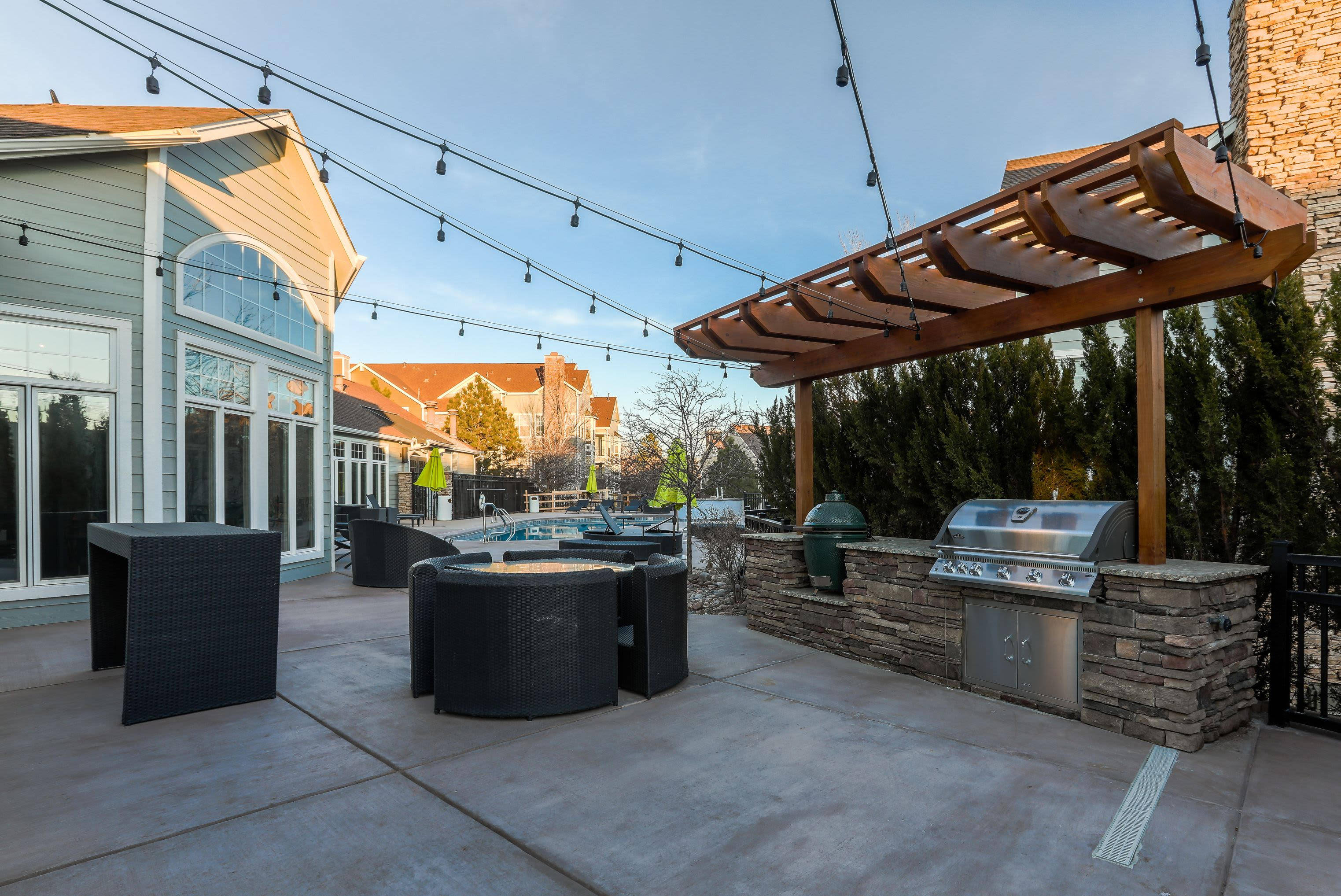 Grills and seating outside at Marquis Castle Pines in Castle Pines, Colorado