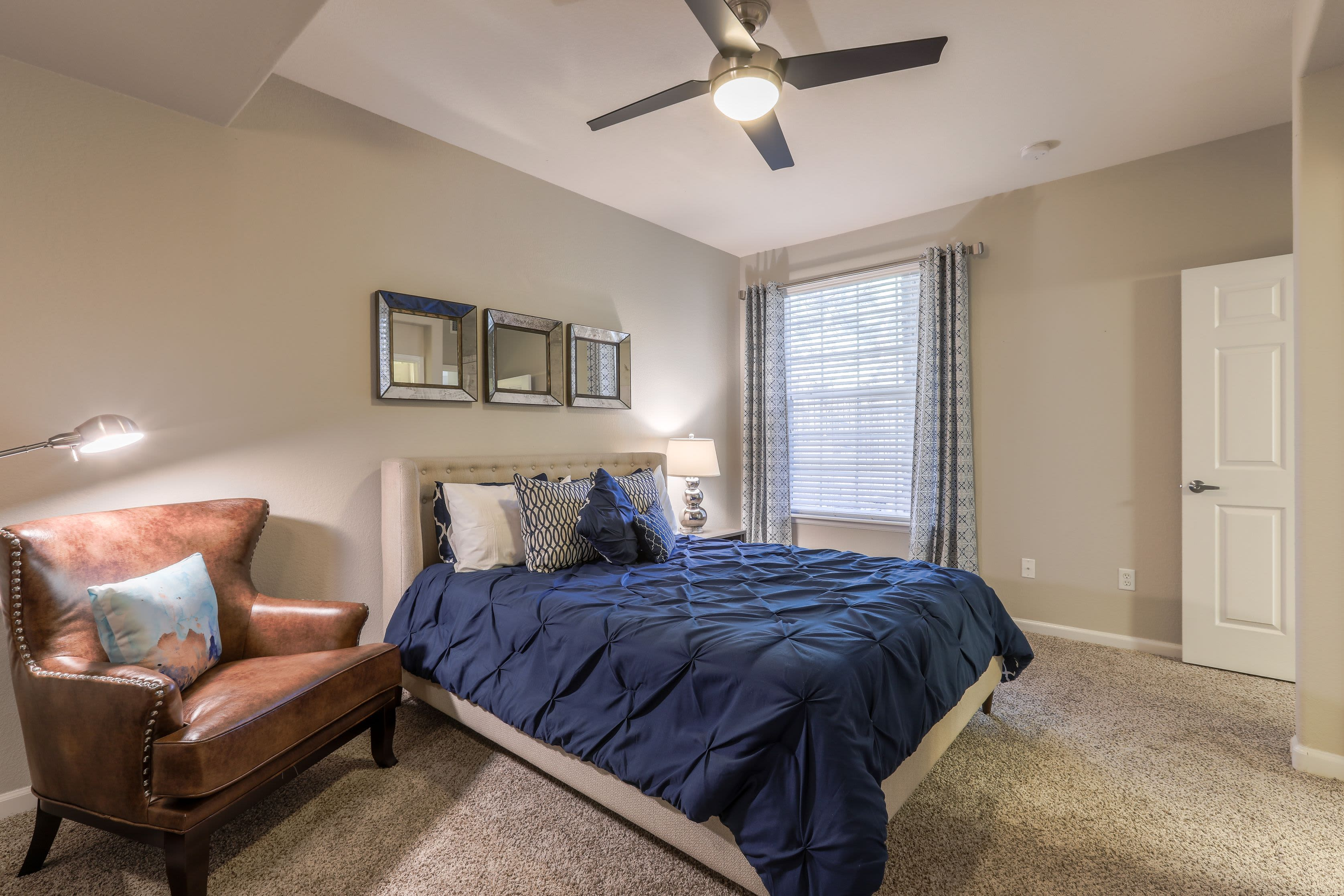 Spacious bedroom with a ceiling fan at Marquis Castle Pines in Castle Pines, Colorado