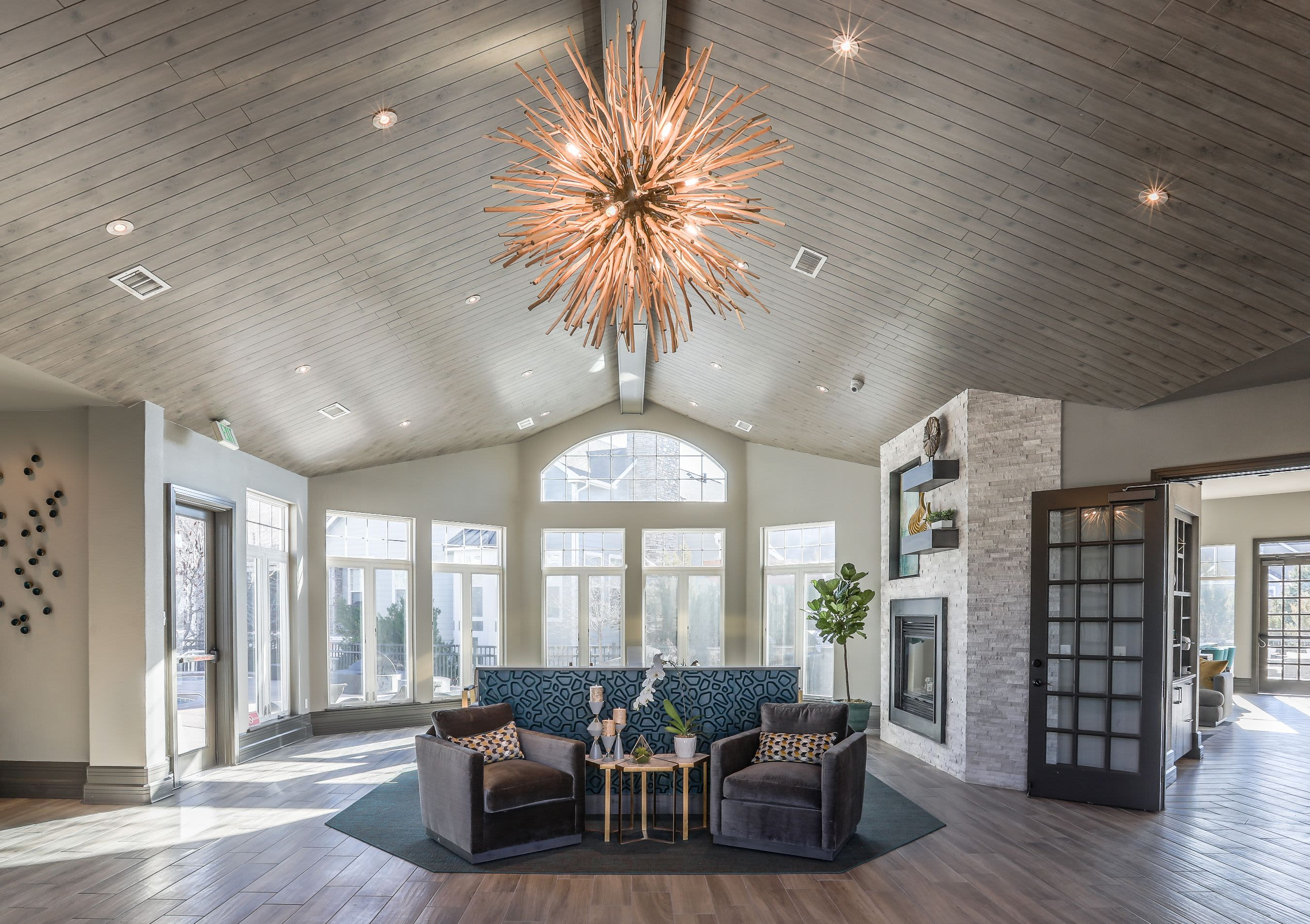 Community clubhouse entrance with seating and a chandelier at Marquis Castle Pines in Castle Pines, Colorado