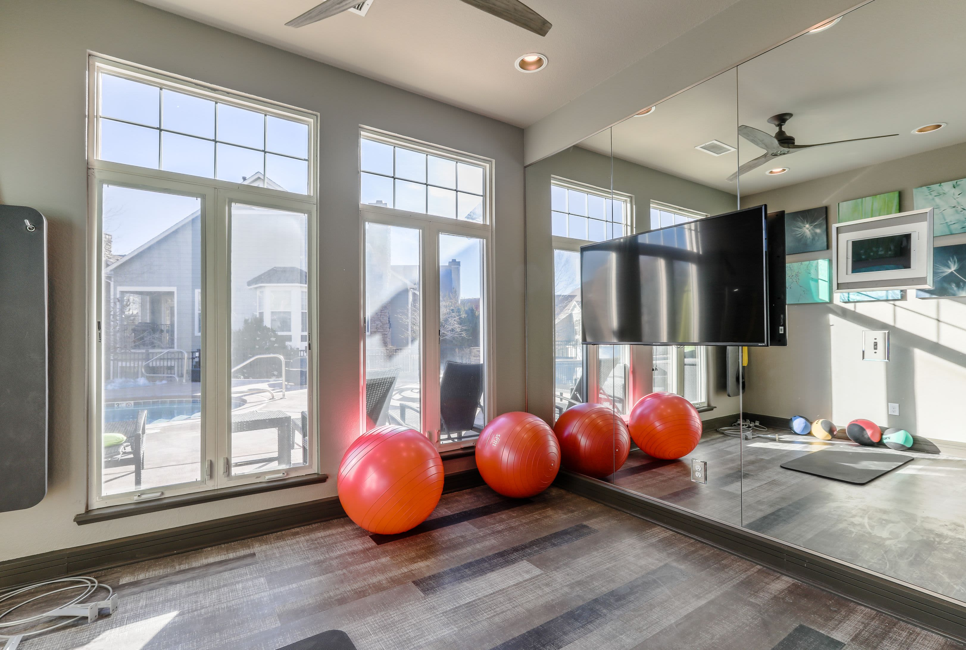 Yoga balls and large mirror in fitness center at Marquis Castle Pines in Castle Pines, Colorado