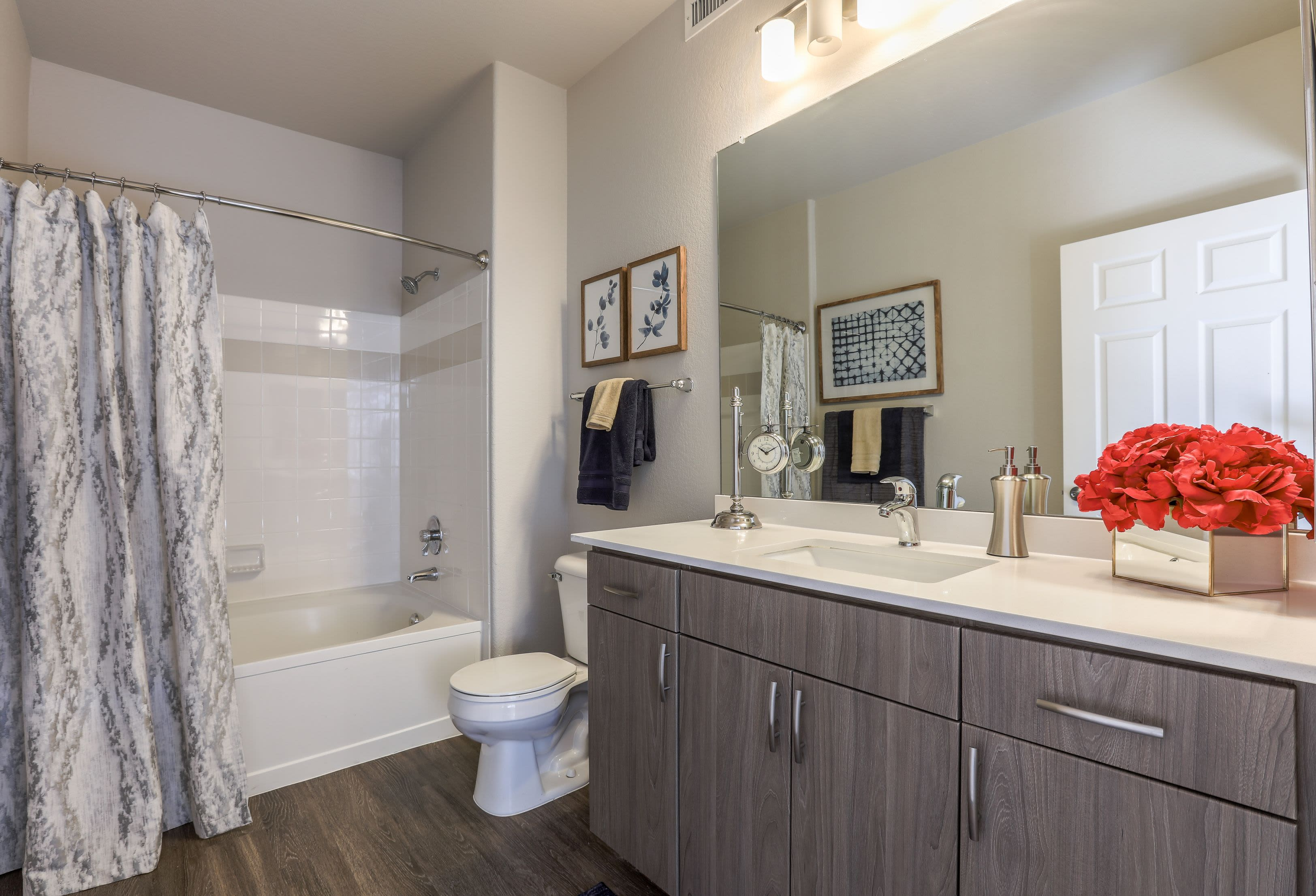 Clean bathroom with wood style floors at Marquis Castle Pines in Castle Pines, Colorado