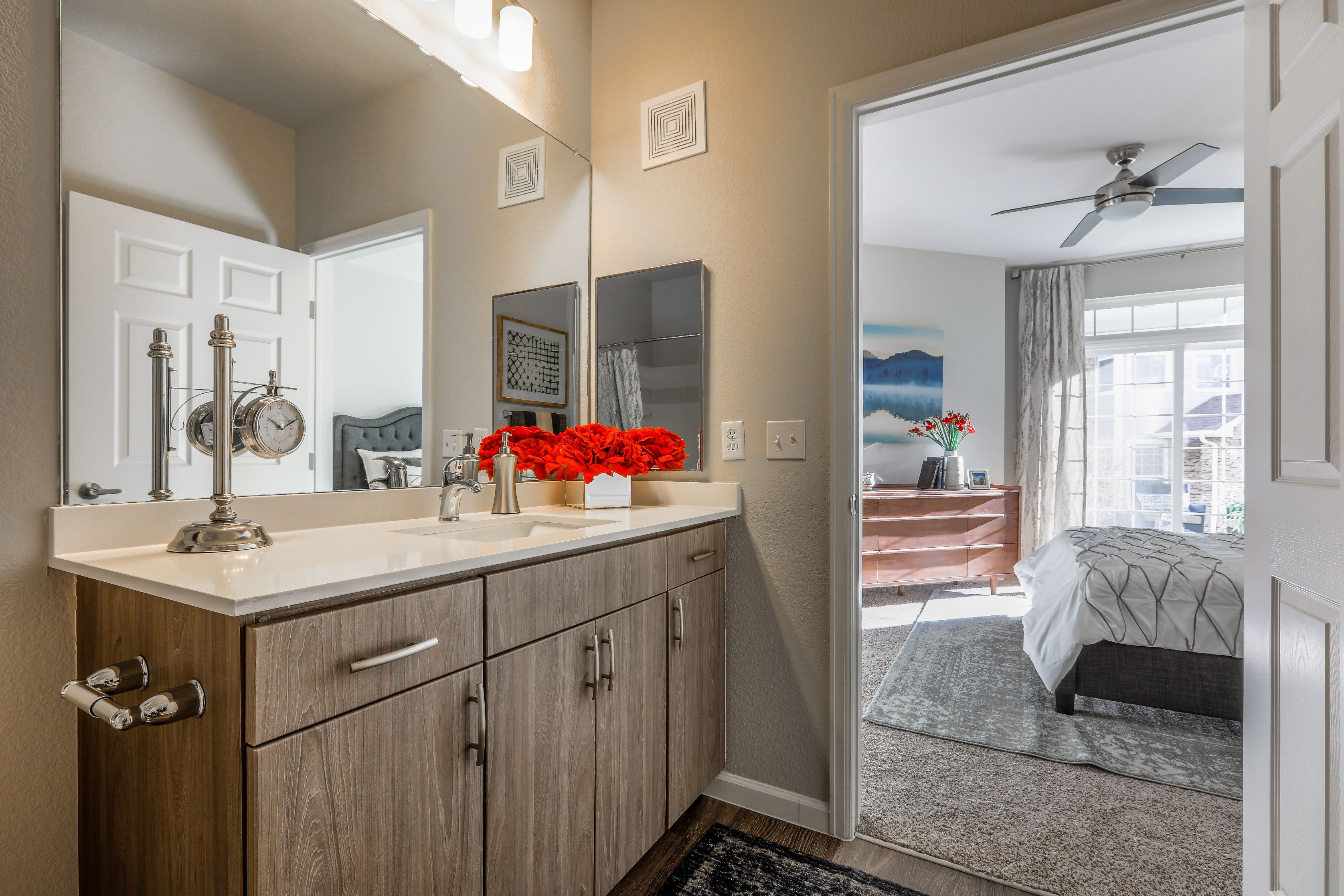 Bright bathroom with white counters at Marquis Castle Pines in Castle Pines, Colorado