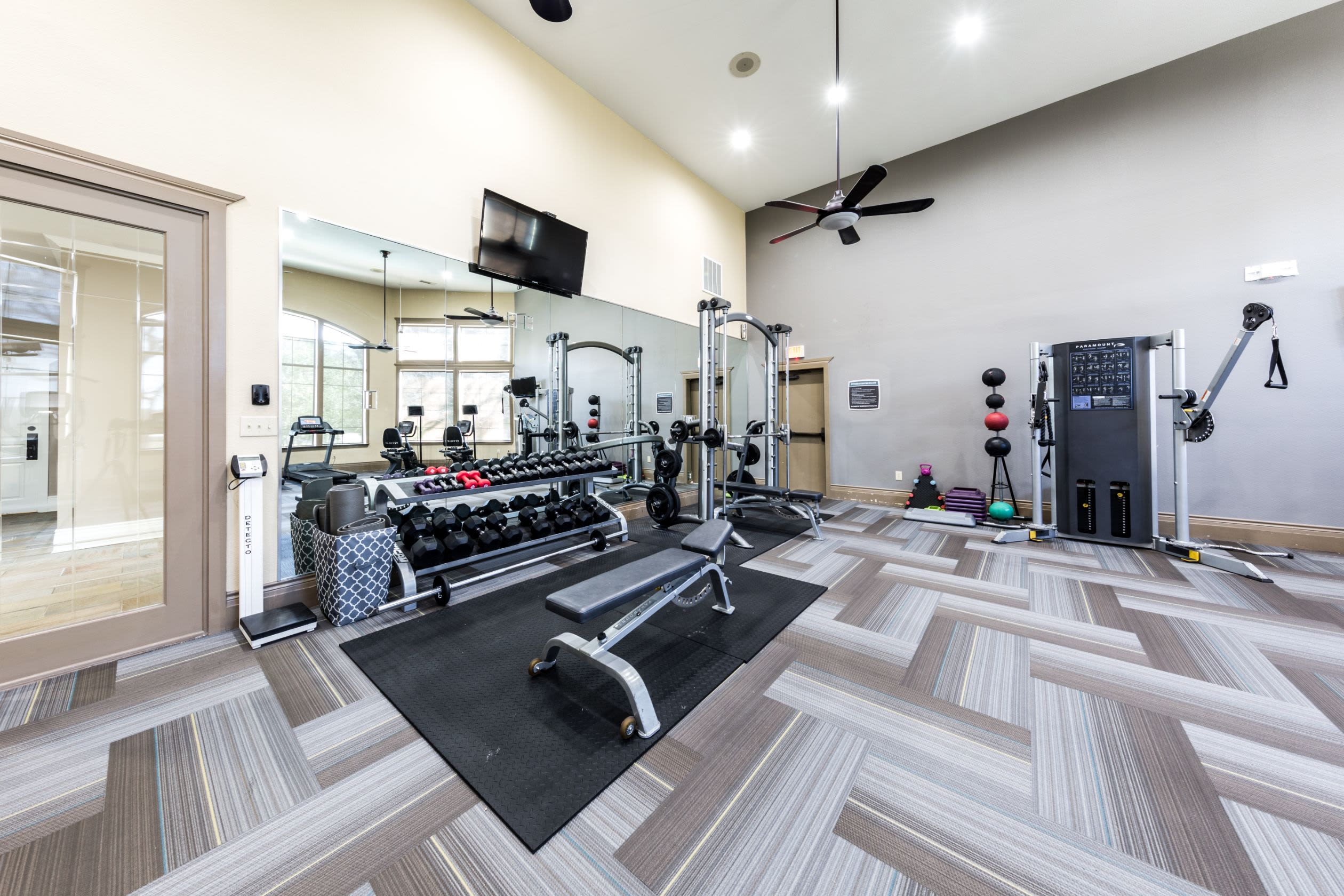 Free weights in the fitness center at The Marquis at Brushy Creek in Austin, Texas