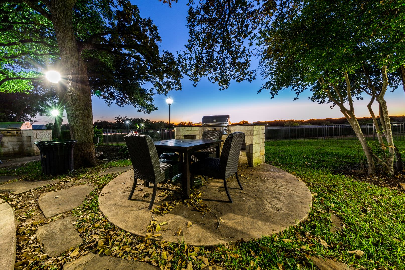 Table and chairs on a patio at sunset at The Marquis at Brushy Creek in Austin, Texas