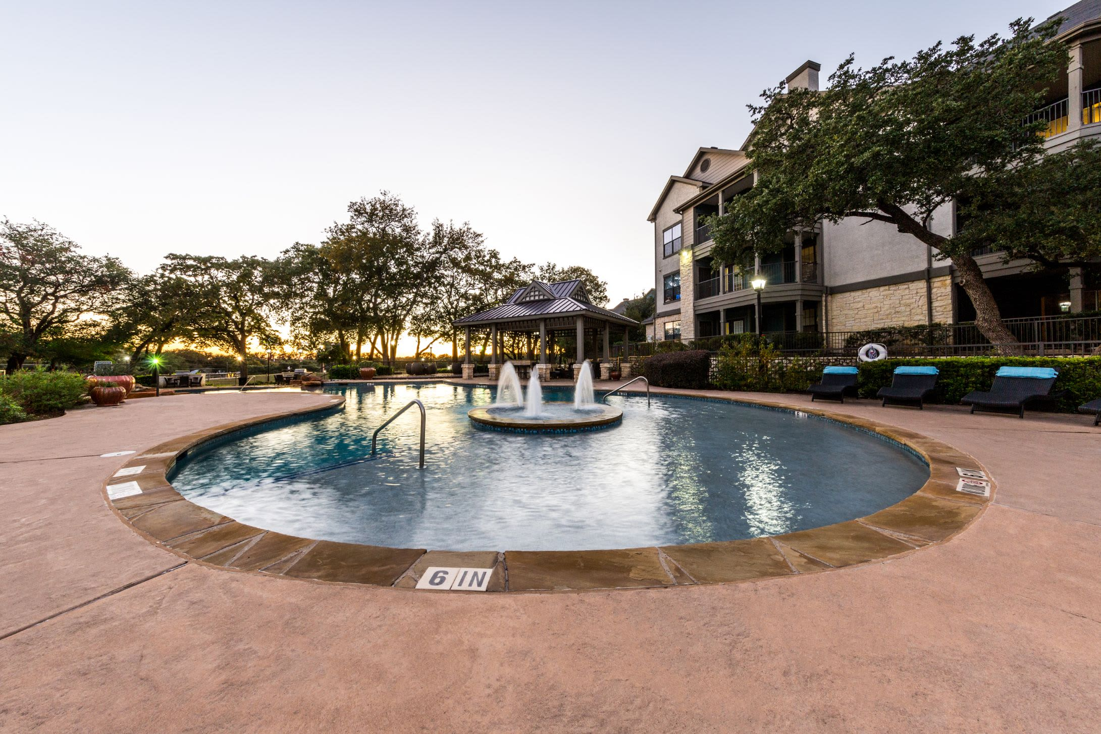 Swimming pool with a fountain in the center at The Marquis at Brushy Creek in Austin, Texas