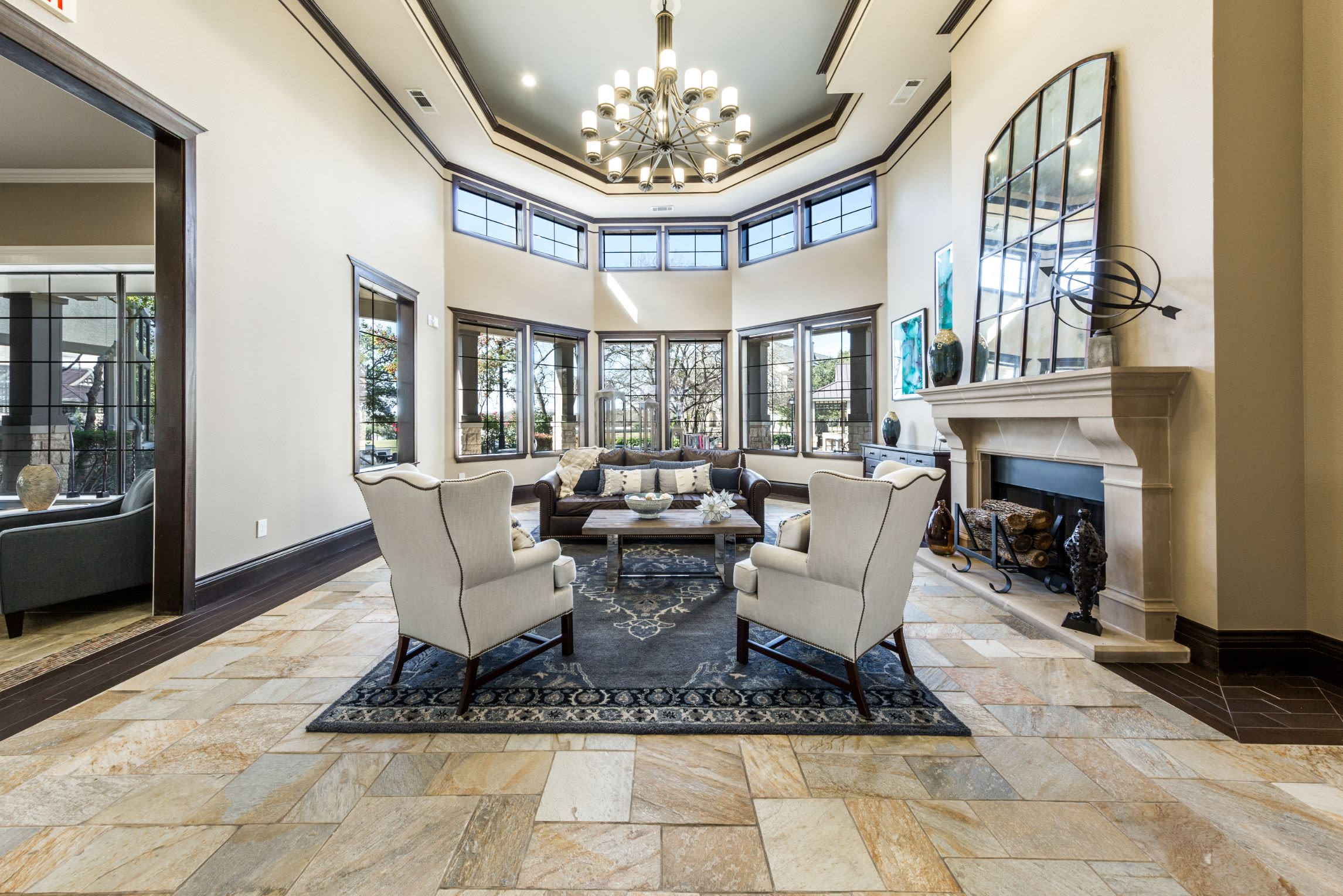Elegant lobby area with a large rug and chandelier at The Marquis at Brushy Creek in Austin, Texas