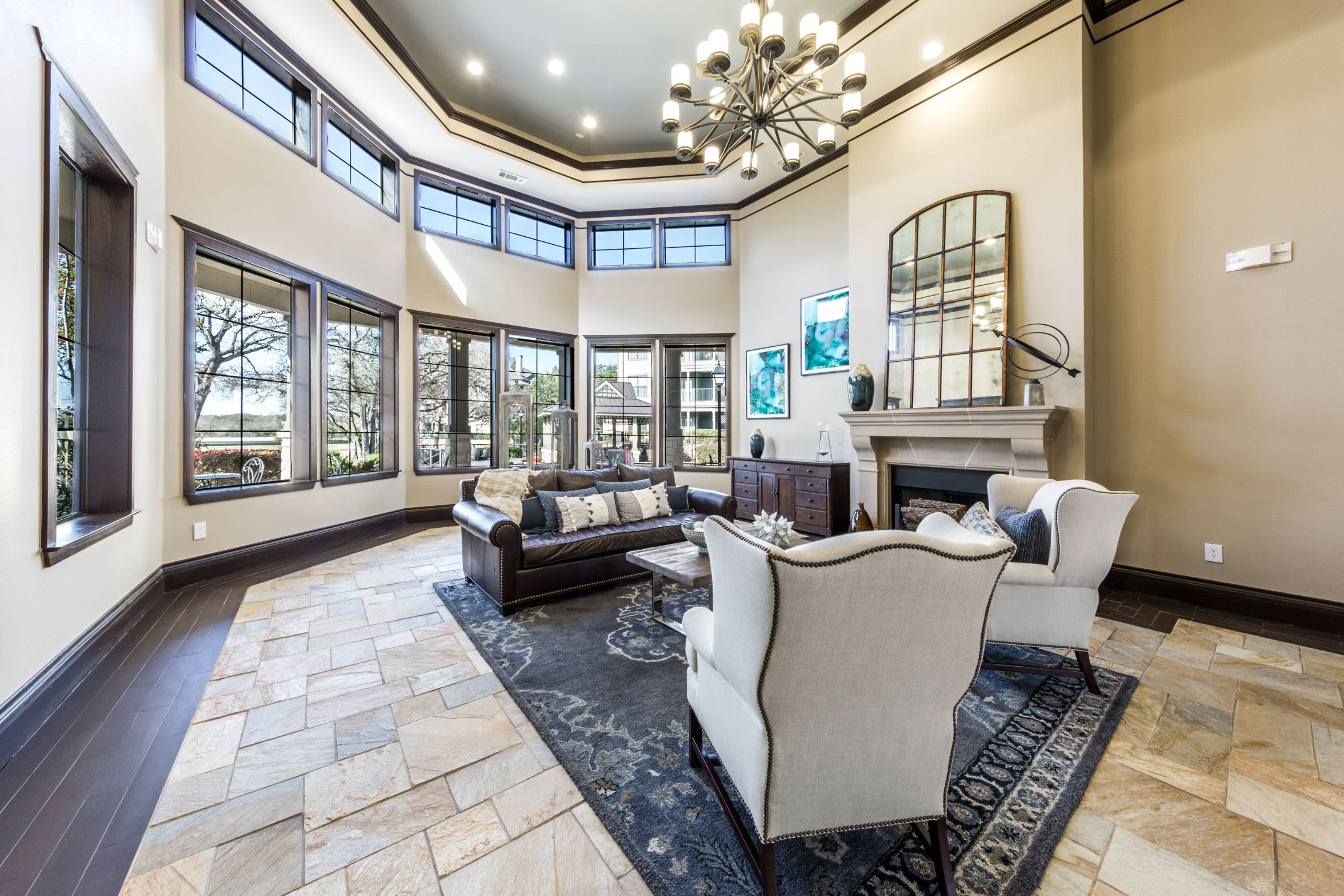 Bright lobby area with multiple large windows and tile floors at The Marquis at Brushy Creek in Austin, Texas